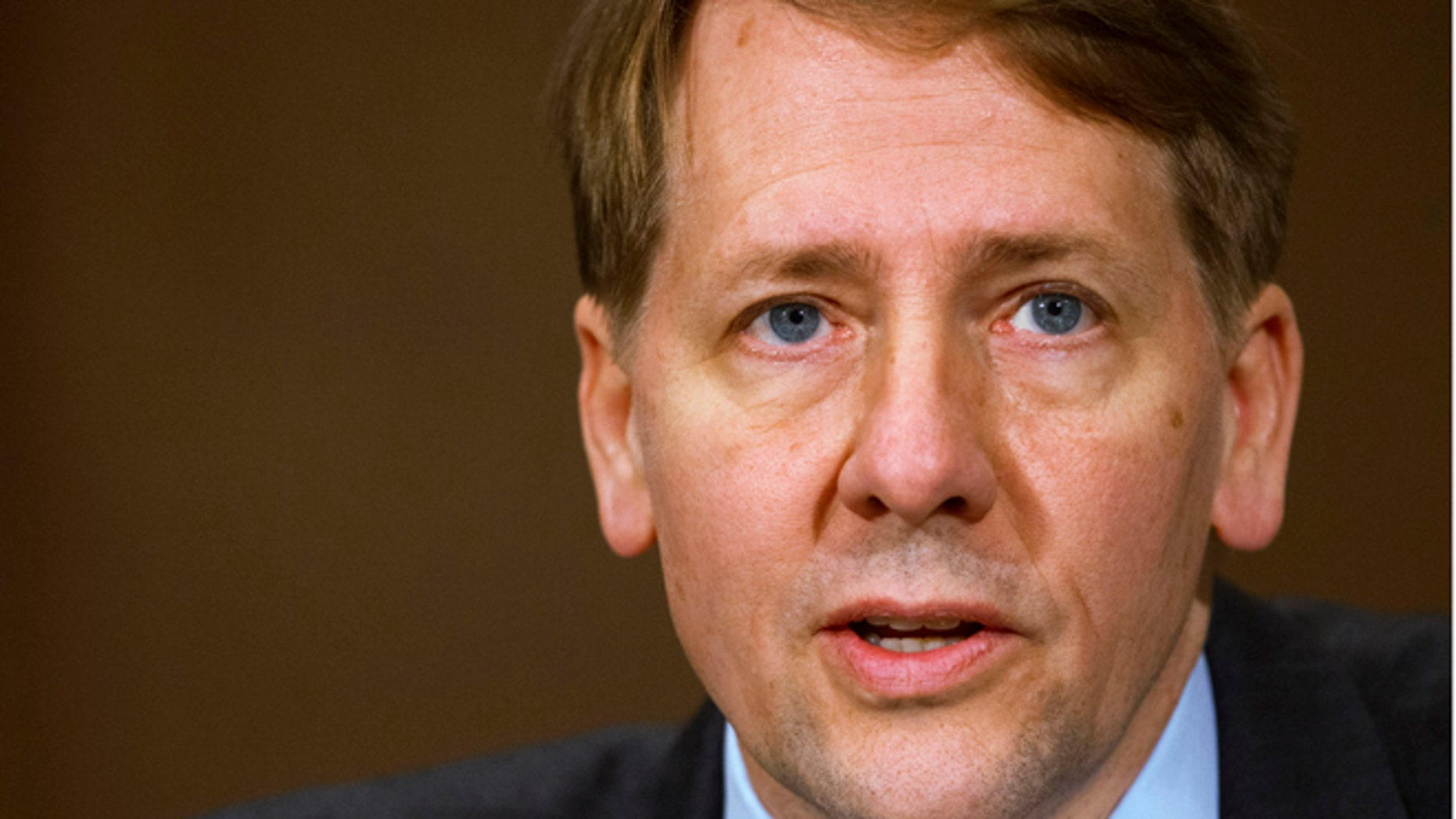 Consumer Financial Protection Bureau Director Richard Cordray testifies before a Senate Committee on Banking hearing on Capitol Hill in Washington.