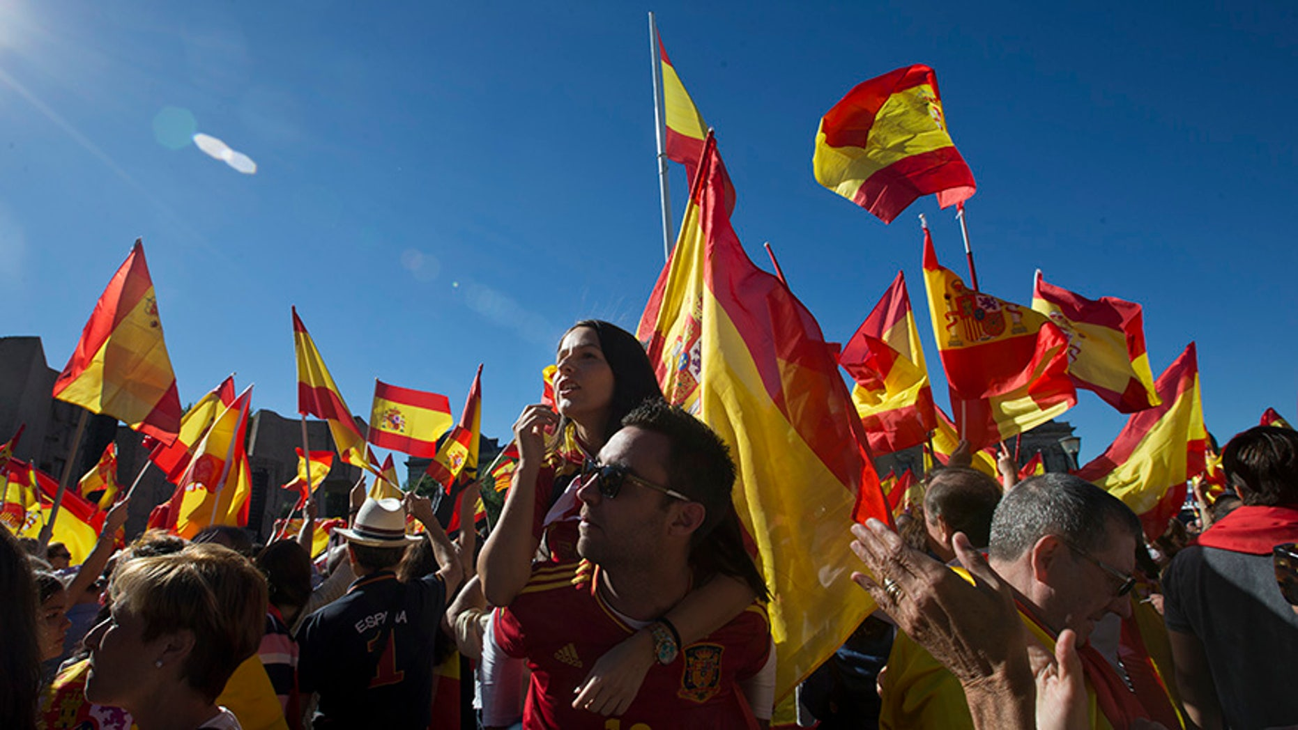 Spaniards pack  Colon Square in Madrid, Spain, Saturday, Oct. 7, 2017. Thousands of pro-Spanish unity supporters donning Spanish flags have rallied in a central Madrid plaza to protest the Catalan regional government's drive to separate from Spain. (AP Photo/Paul White)