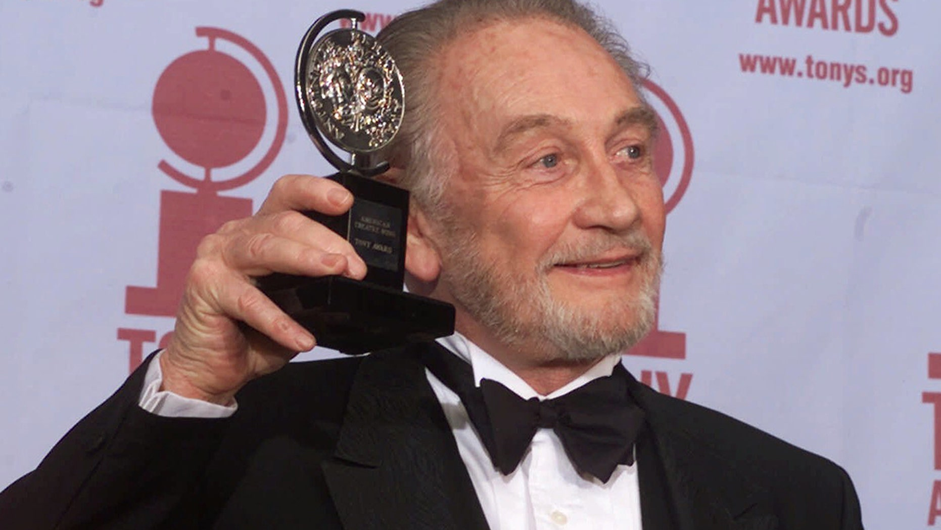 """In this file photo dated Sunday, June 4, 2000, Roy Dotrice poses with his Tony award for Best Featured Actor in a Play for his work in """"A Moon For The Misbegotten,"""" at the 54th annual Tony Awards ceremony in New York. The family of veteran British actor Roy Dotrice said Monday Oct. 16, 2017, that he has died aged 94, in his London home."""