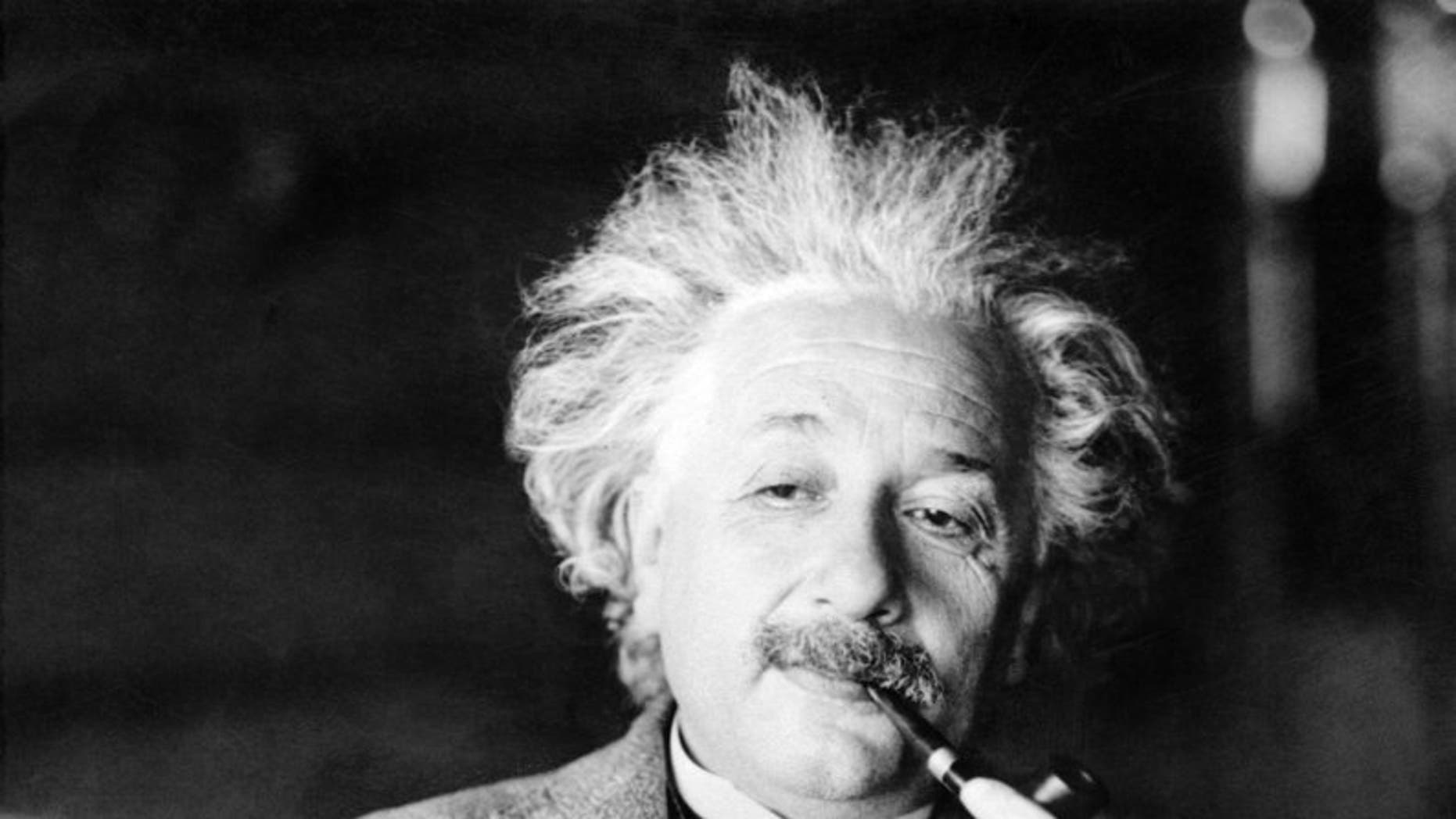 Albert Einstein's handwritten note to a bellboy while traveling in Japan in 1922 fetched $1.56 million at a Jerusalem auction, The Winner auction house said.