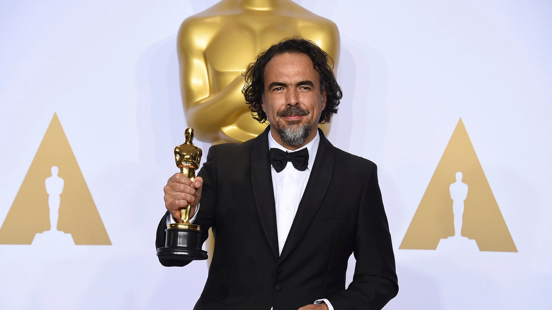 """Alejandro Iñárritu, seen with the Academy Award he won for """"The Revenant,"""" will be given a special Oscar for his virtual reality installation, """"CARNE Y ARENA,"""" the Academy's Board of Governors announced Friday."""