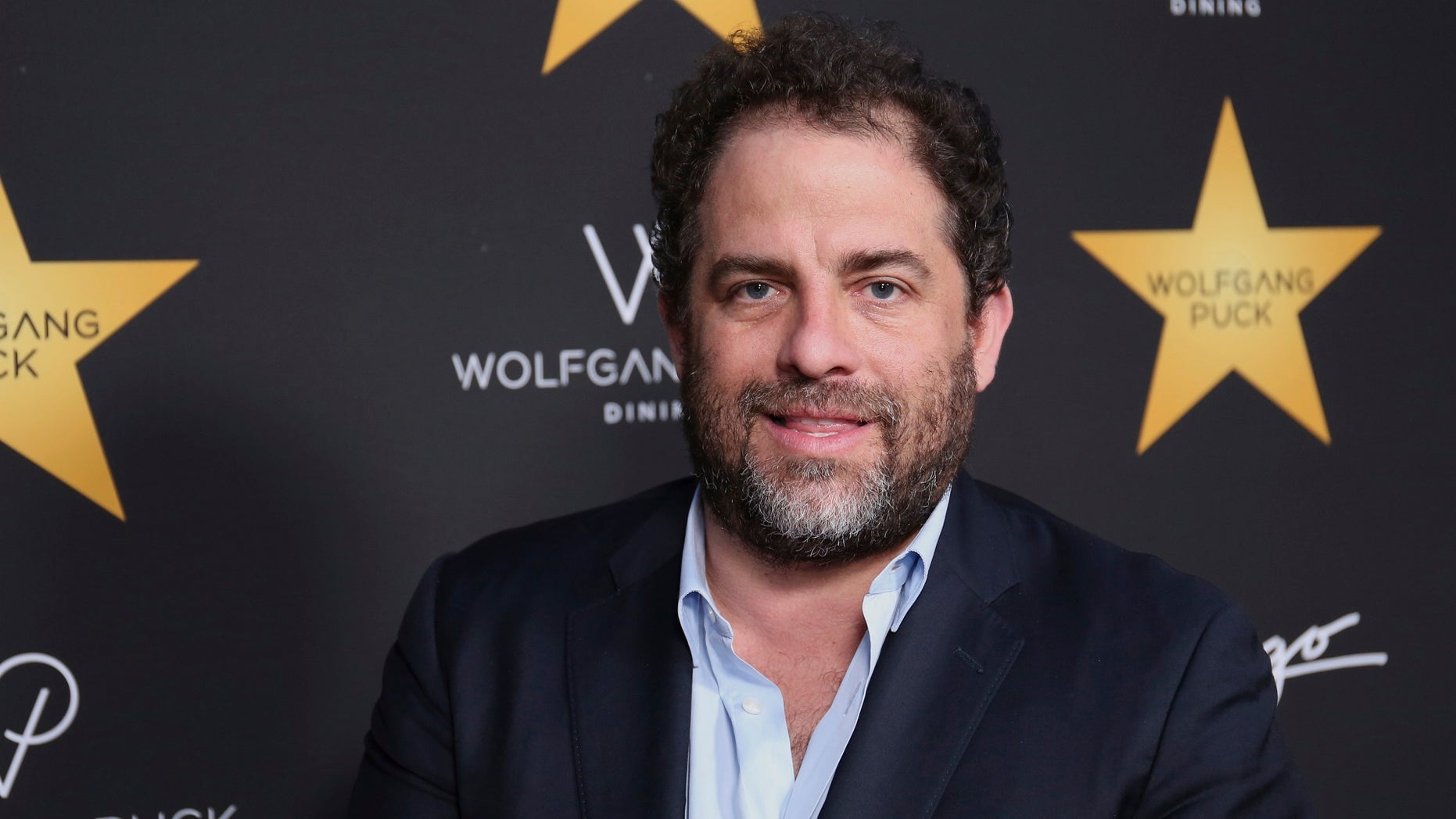 Playboy has decided to hold off working with Brett Ratner's movie house following sexual assault allegations.
