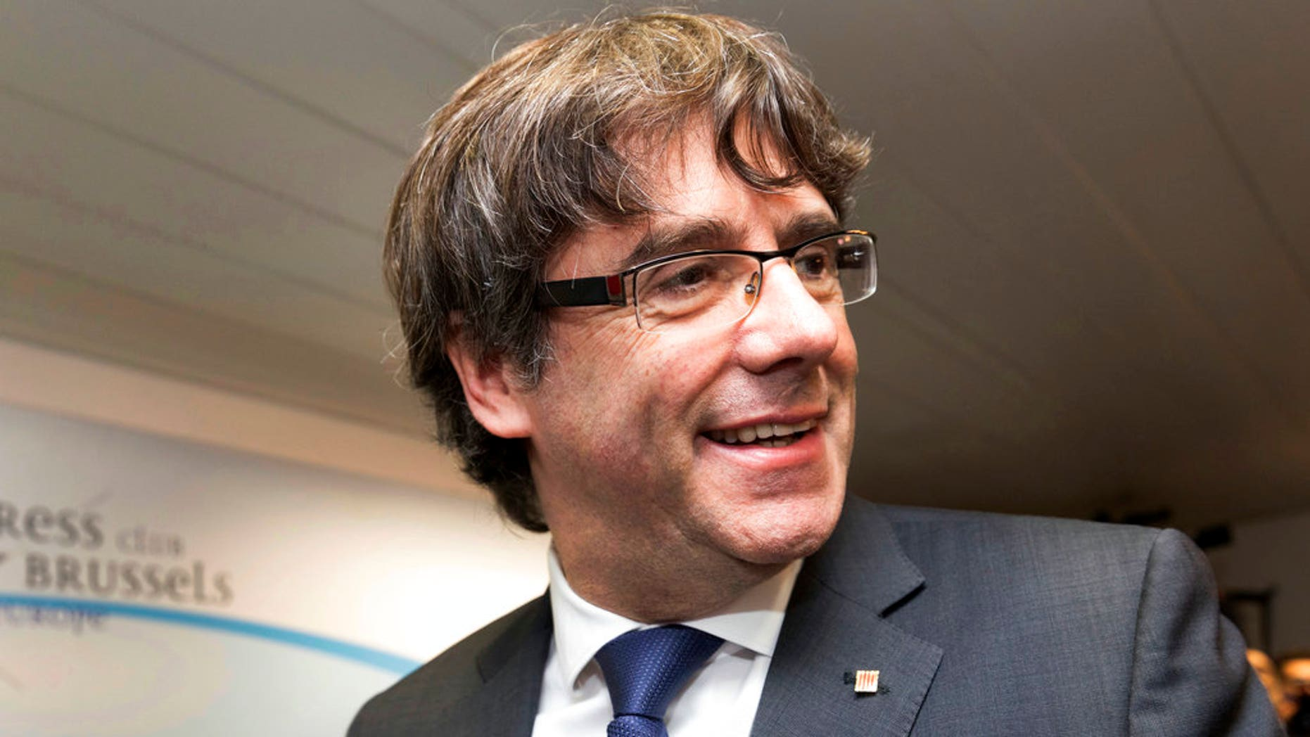 Ousted Catalan President Carles Puigdemont reportedly turned himself in to police in Brussels on Sunday.
