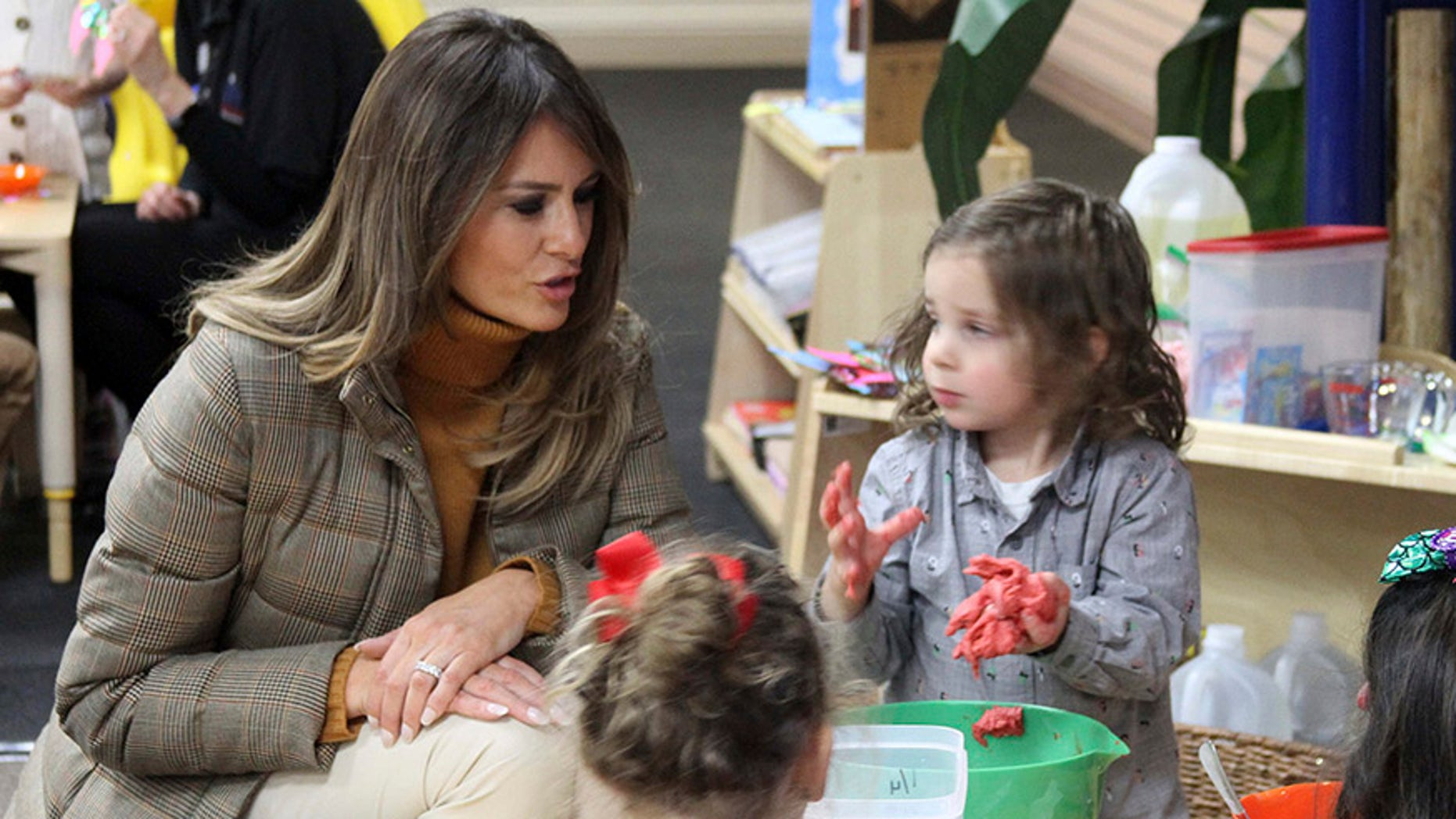 First Lady Melania Trump plays with children at Joint Base Elmendorf-Richardson, Alaska, on Nov. 10, 2017