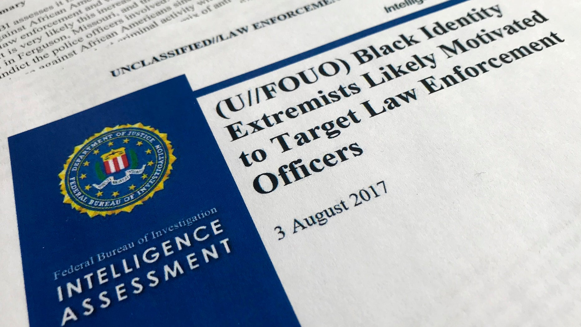 "In this Nov. 17, 2017, photo, the cover page of a FBI report on the rise of black ""extremists"" is photographed in Washington. The report is stirring fears of a return to practices of the Civil Rights era, when the agency notoriously spied on activist groups without evidence they had broken any laws. Attorney General Jeff Sessions, a former Alabama senator whose career has been dogged by questions about race and his commitment to civil rights, did not ease lawmakers' concerns when he was unable to answer questions about the report or its origins during a congressional hearing on Nov. 14. (AP Photo/Jon Elswick)"
