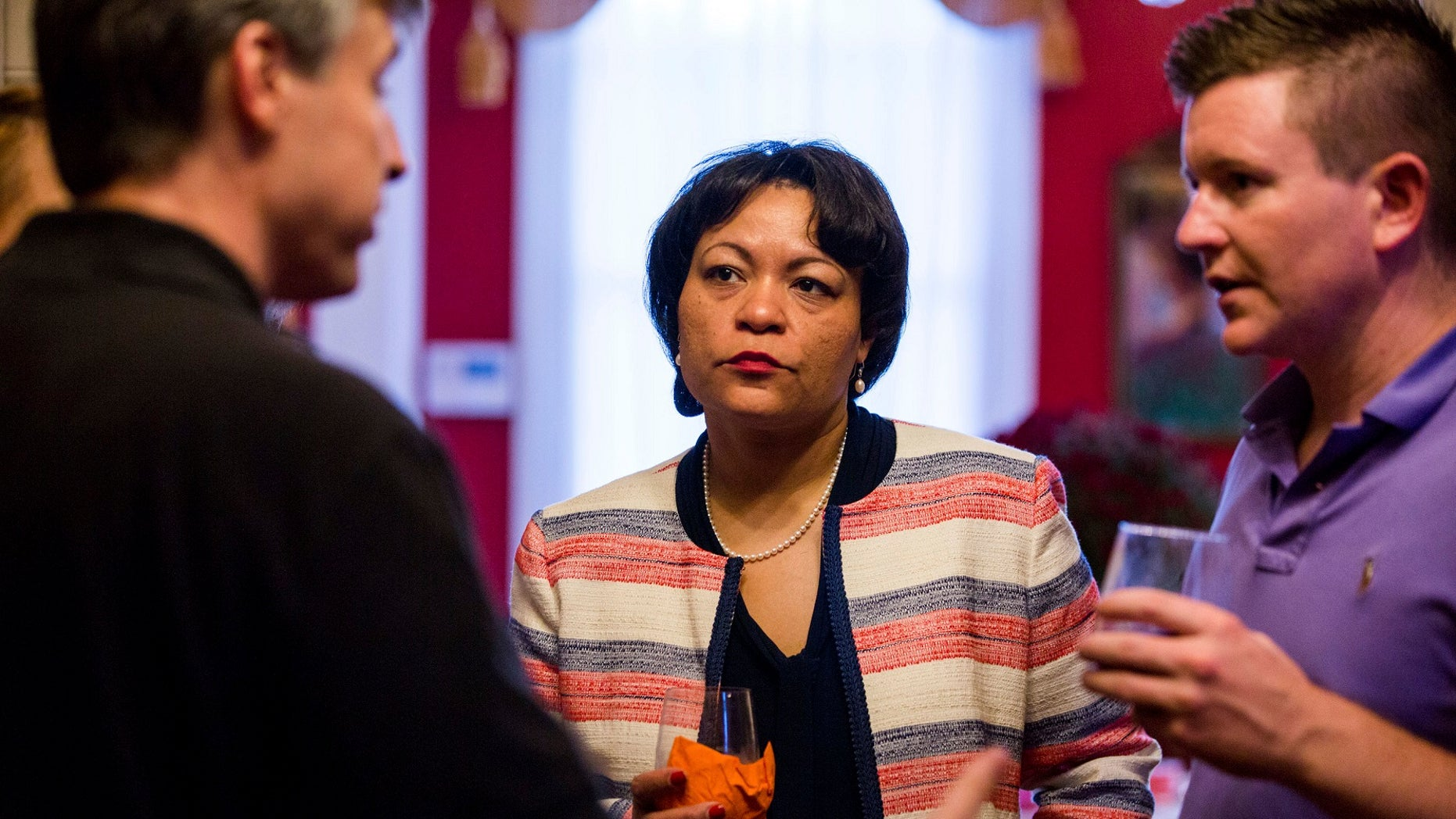 Democrat LaToya Cantrell, center, listens to campaign donors, Sept. 22, 2017.