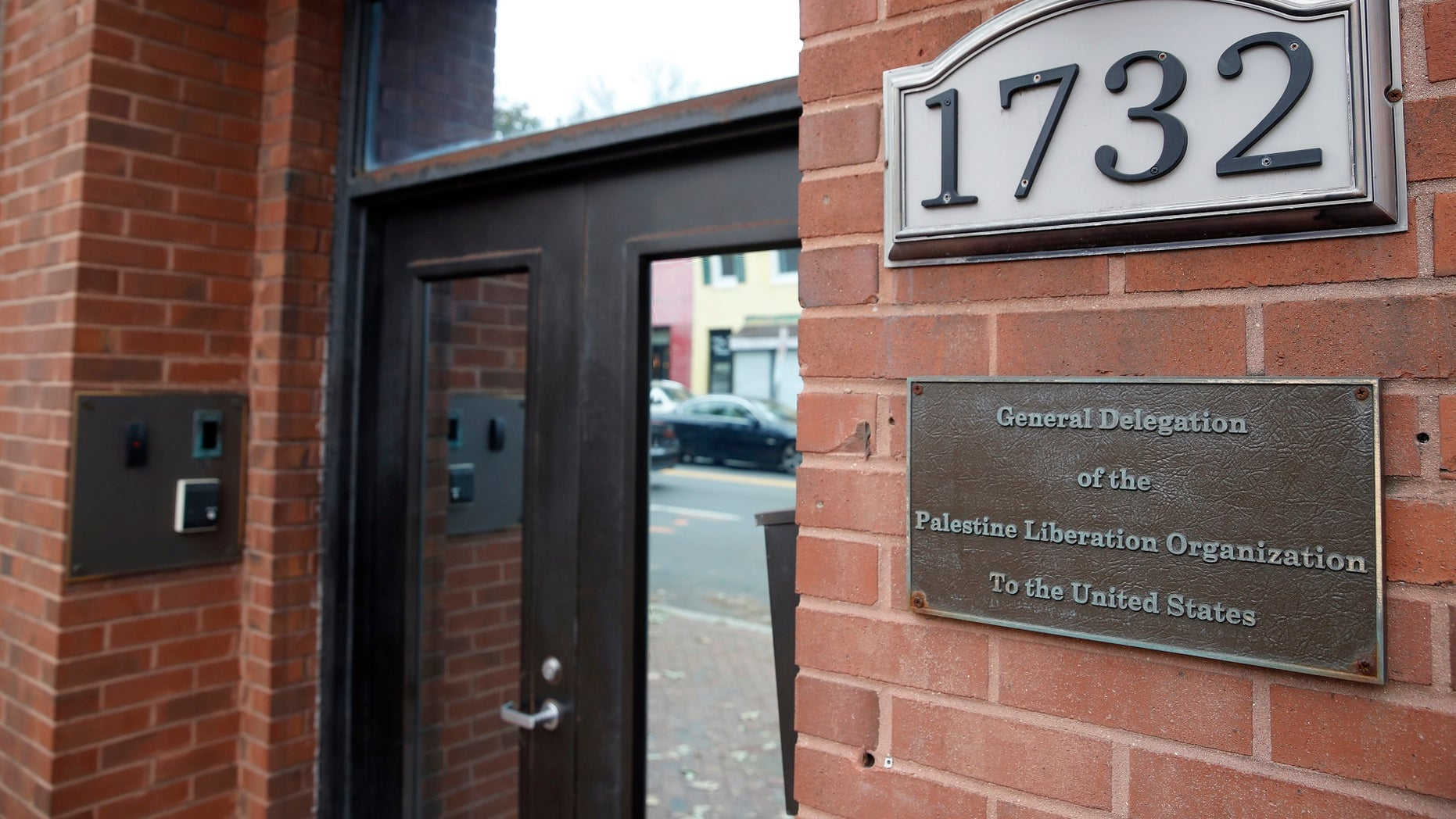 FILE- This Saturday, Nov. 18, 2017, file photo shows the Washington office of the Palestine Liberation Organization. Last week, U.S. officials said the Palestine Liberation Organization mission in Washington had to close because the Palestinians had violated a provision in U.S. law. But the State Department said Friday, Nov. 24, that the office can stay open, with restrictions. (AP Photo/Alex Brandon, File)