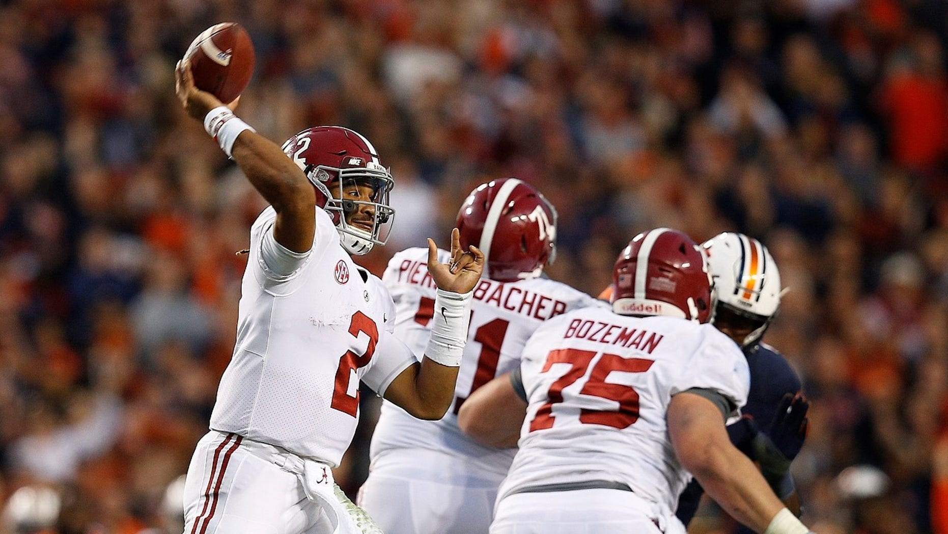 Alabama quarterback Jalen Hurts throws the ball during the second half of the Iron Bowl NCAA college football game, in Auburn, Ala.