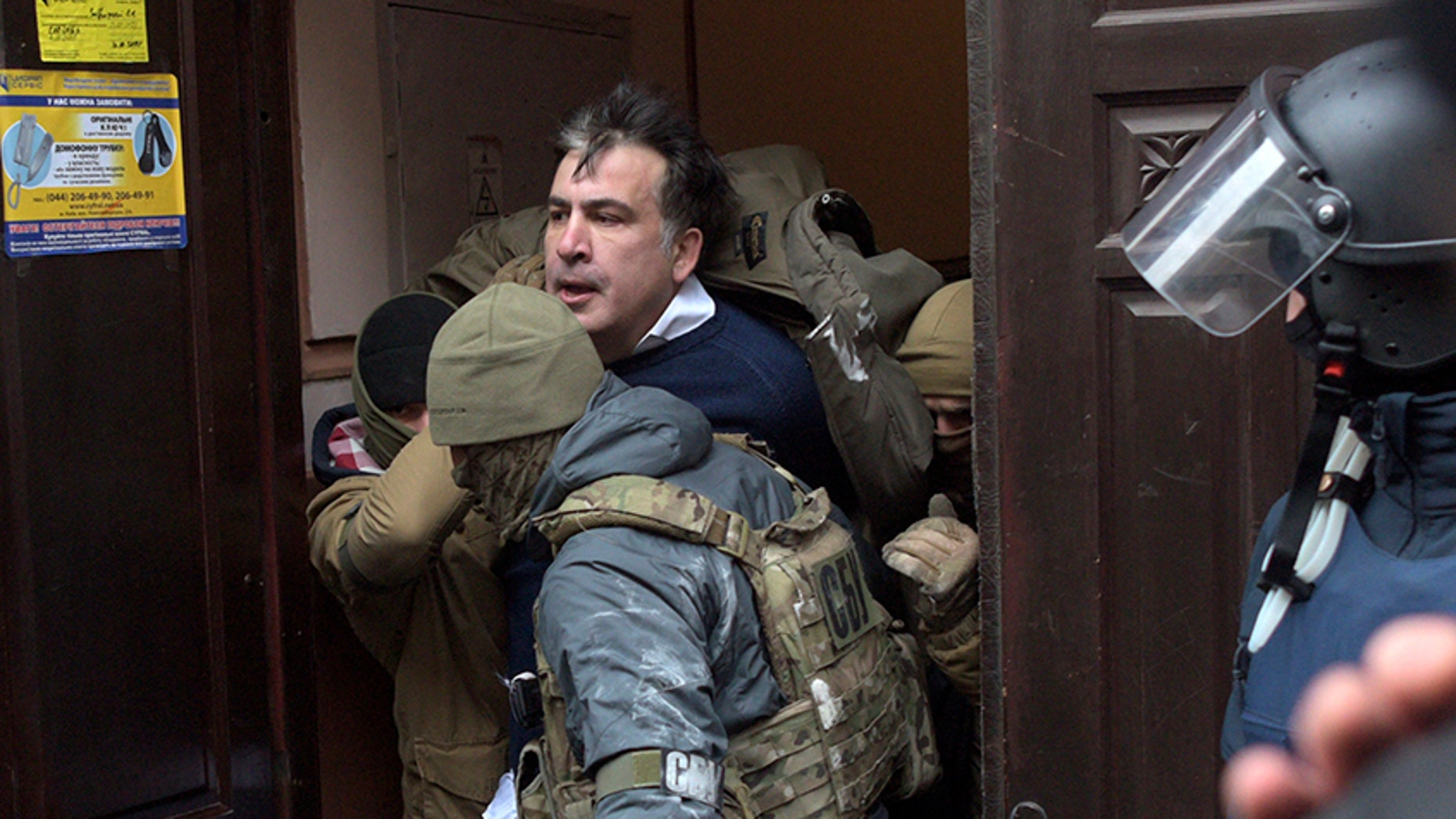 The Ukrainian Security Service officers detain Mikheil Saakashvili at the entrance of his house in Kiev, Ukraine.