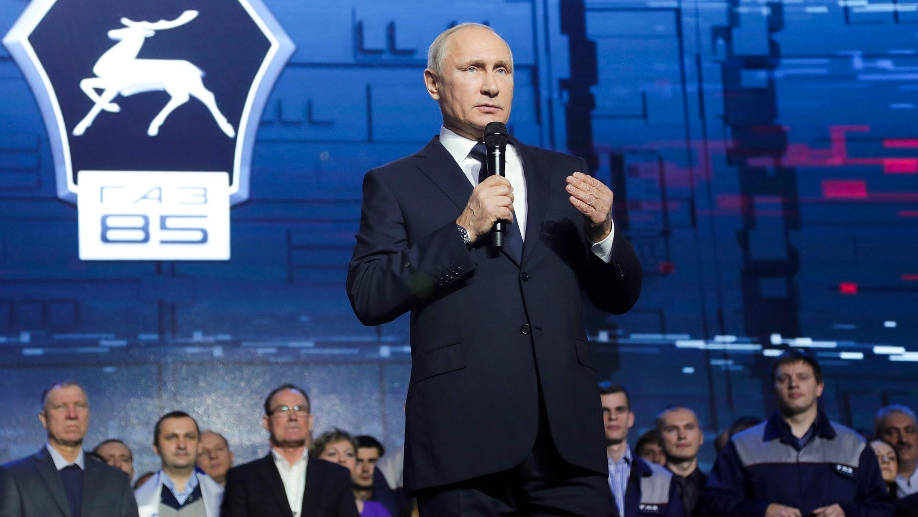 Russian President Vladimir Putin speaks at a meeting with workers of the GAZ factory in Nizhny Novgorod, Russia, Wednesday, Dec. 6, 2017. Putin says he will seek re-election in next March's election