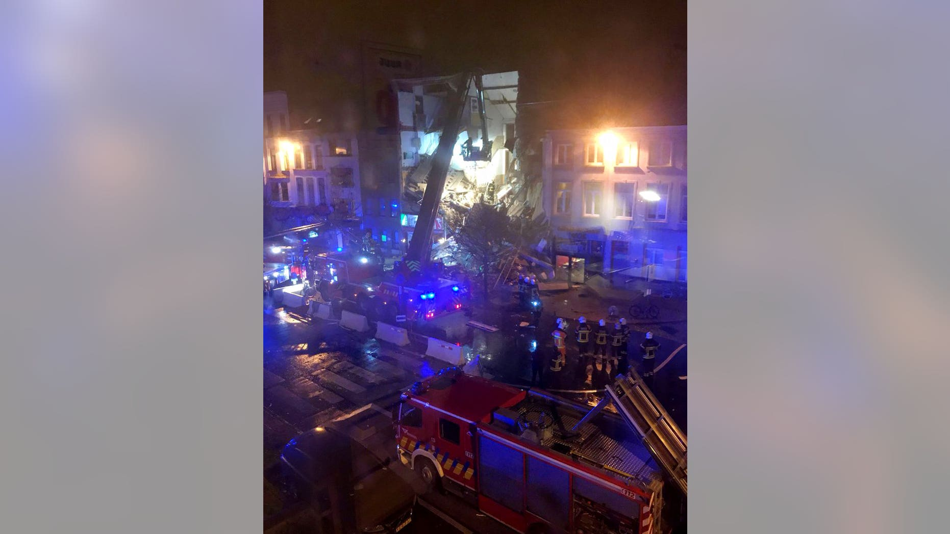 Up to 20 people may have been injured, with some trapped under rubble, after an explosion tore through a residential building Tuesday night in Belgium.