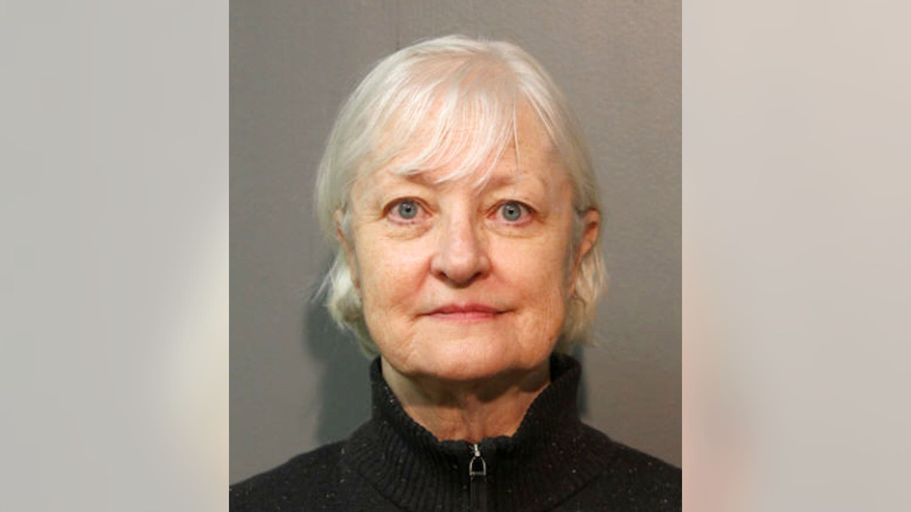 In this Jan. 2018, photo provided by the Chicago Police Department, Marilyn Hartman is seen posing for a mugshot in Chicago.  (Chicago Police Department via AP)