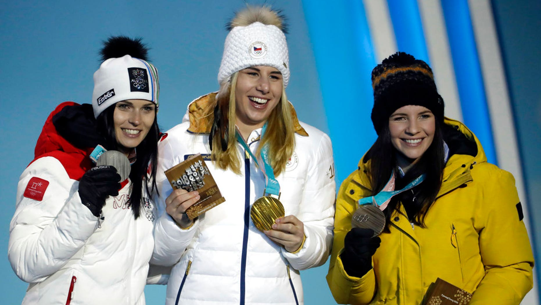 Medalists in the women's super-G, from left: Austria's Anna Veith, silver; Czech Republic's Ester Ledecka, gold; and Liechtenstein's Tina Weirather, bronze, are seen at the 2018 Winter Olympics in South Korea, Feb. 17, 2018.
