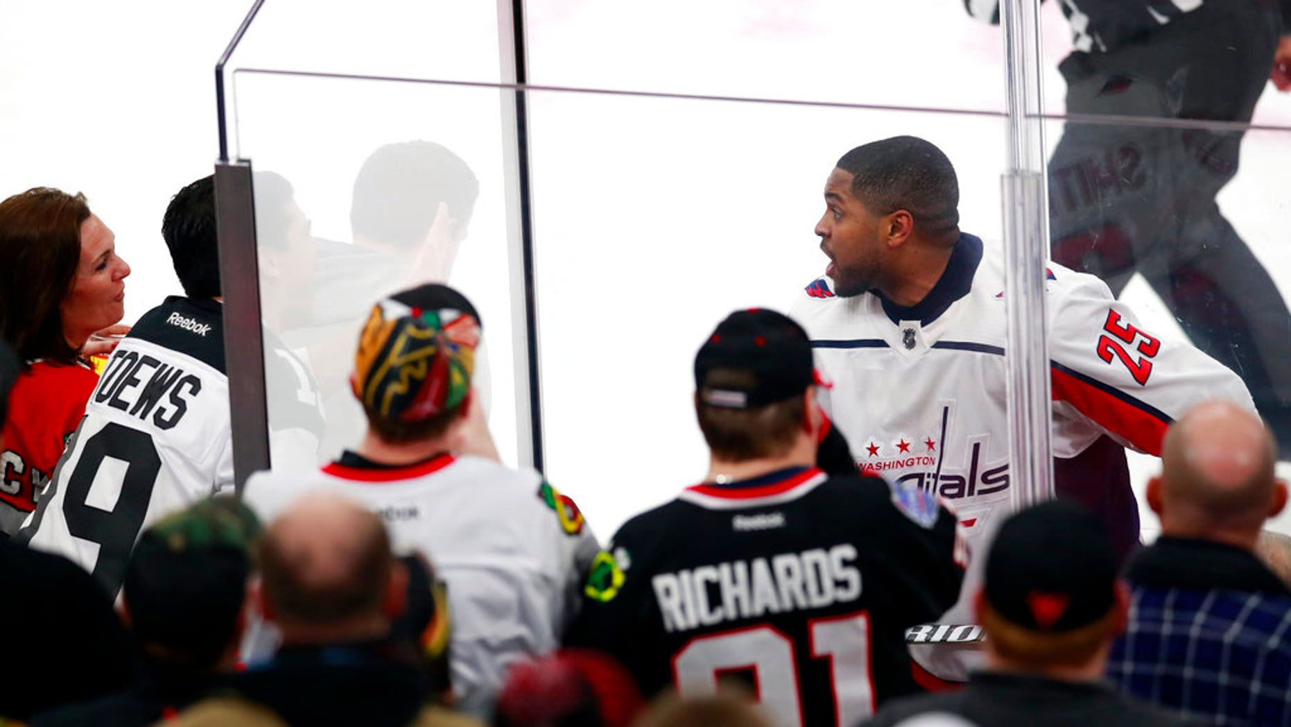 Washington Capitals' Devante Smith-Pelly argues with Chicago Blackhawks fans from the penalty box during the third period of an NHL hockey game Saturday night, in Chicago.