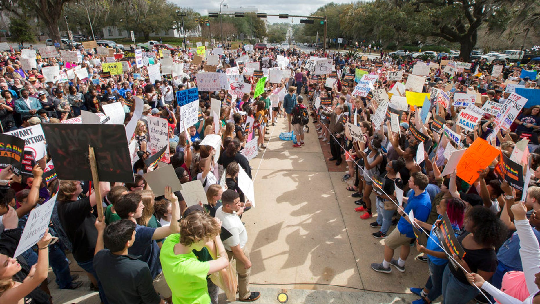 Students gather on the steps of the old Florida Capitol protesting gun violence in Tallahassee, Florida, on Wednesday. A school district in Texas has threatened to suspect students who participate in similar protest events.