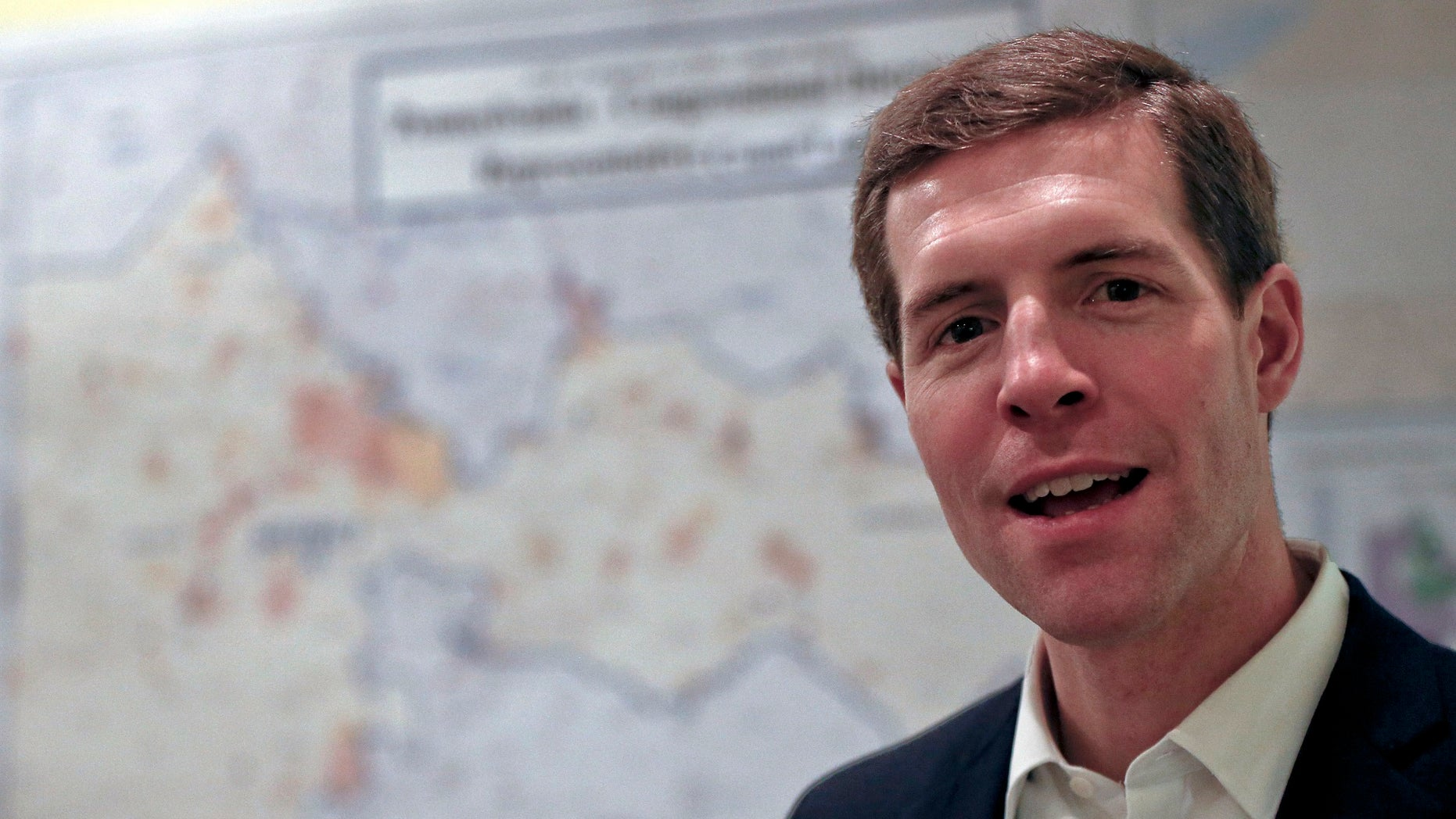 Democrat Conor Lamb stands in front of the map of the congressional district he was running to represent while at a campaign office, Wednesday, March 7, 2018 in Carnegie, Pa. Lamb was elected in a special election held March 13 for the PA district vacated by Republican Tim Murphy.
