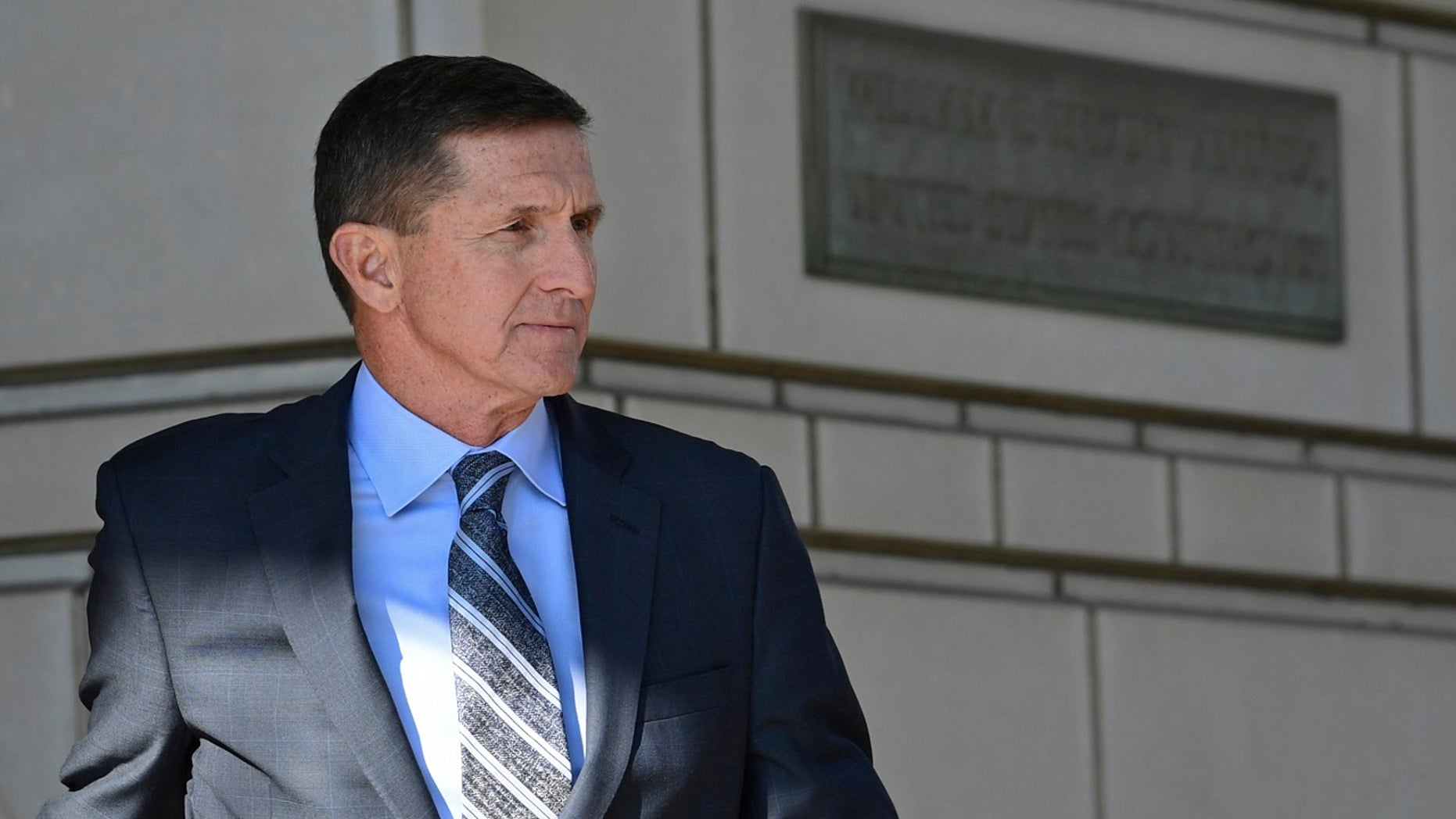 Former Trump national security adviser Michael Flynn leaves federal court in Washington, Dec. 1, 2017.