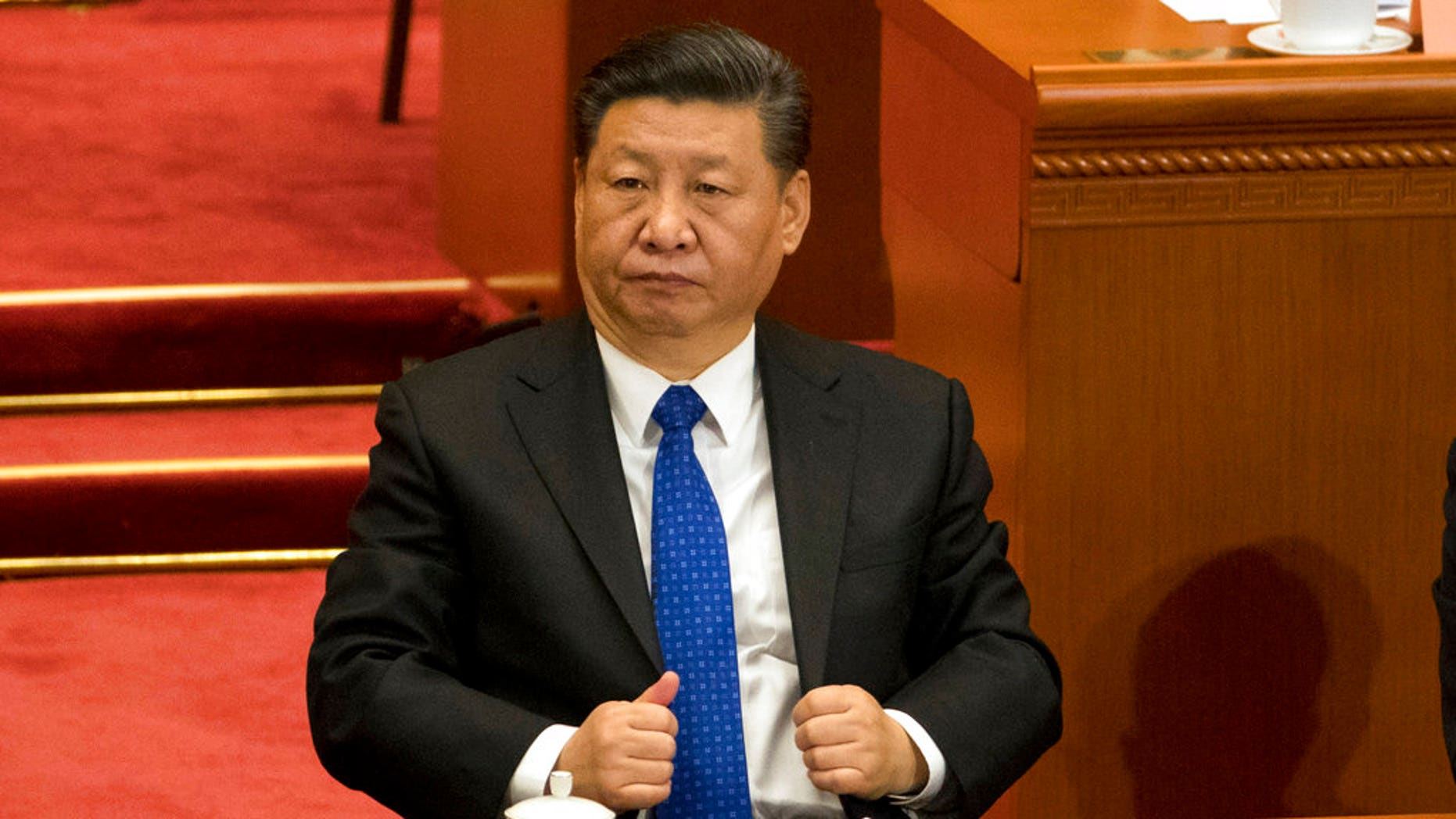 Chinese President Xi Jinping attends the opening session of the Chinese People's Political Consultative Conference in Beijing's Great Hall of the People.