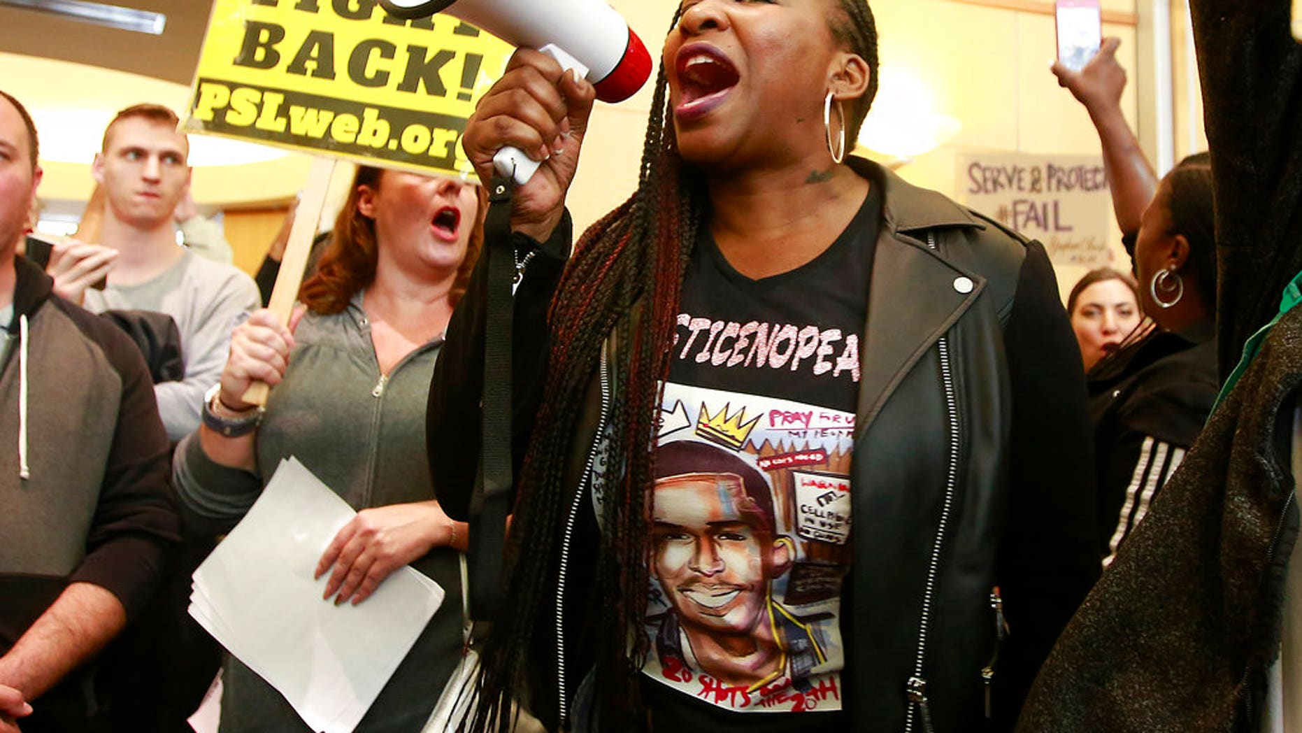 Veronica Curry and others protest the fatal shooting of Stephon Clark, outside City Hall in Sacramento, Calif., March 22, 2018.