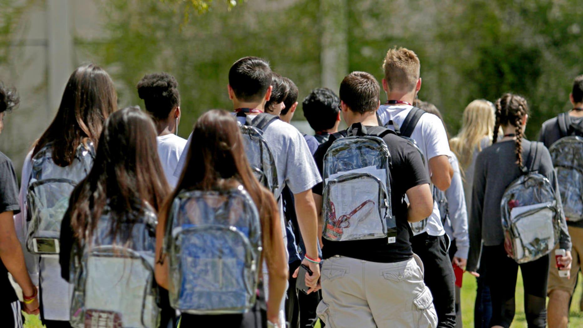 1f657dc409 Students wear clear backpacks outside of Marjory Stoneman Douglas High  School in Parkland
