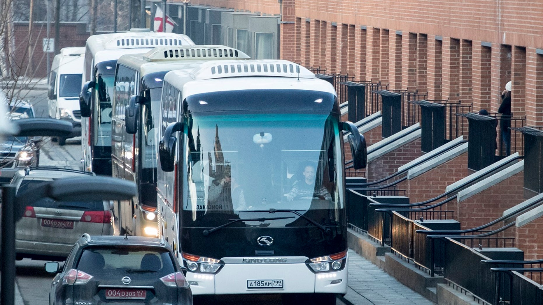 Buses believed to be carrying expelled diplomats prepare to leave the U.S. Embassy in Moscow, Russia, Thursday, April 5, 2018.