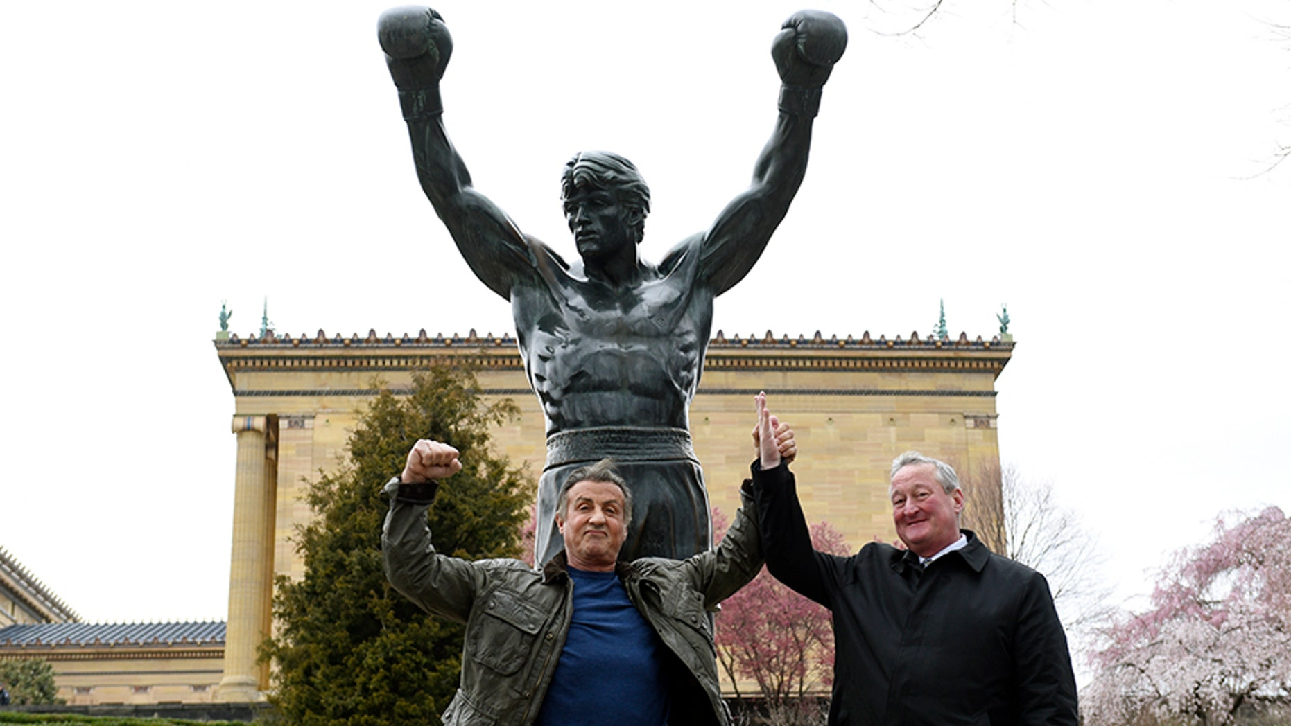 Sylvester Stallone, left, poses with Philadelphia Mayor Jim Kenney in front of the Rocky statue at the Philadelphia Art Museum on Friday.