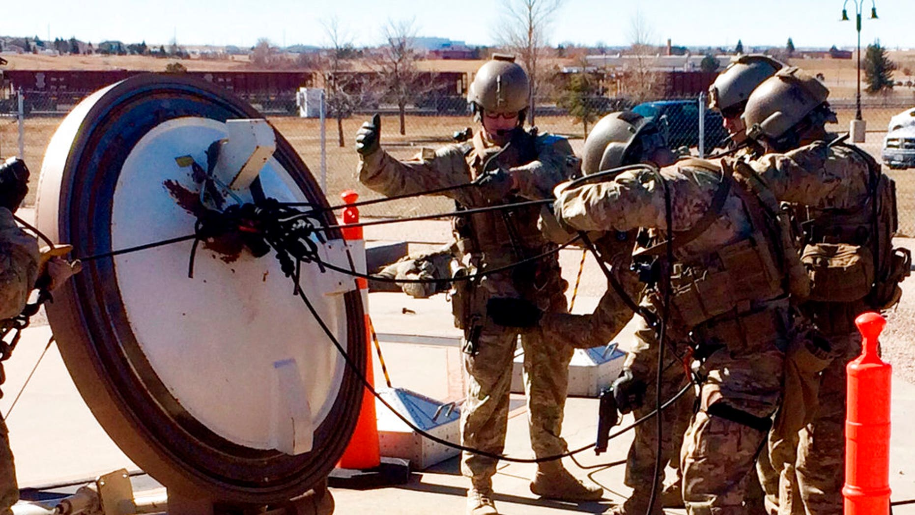 In this February 2016 photo, members of the 790th Missile Security Forces Squadron demonstrate their training for recapturing a Minuteman missile silo after being taken over by an intruder/attacker, just days before the Air Force announced the drug investigation, at the Francis E. Warren Air Force Base, near Cheyenne, Wyo.