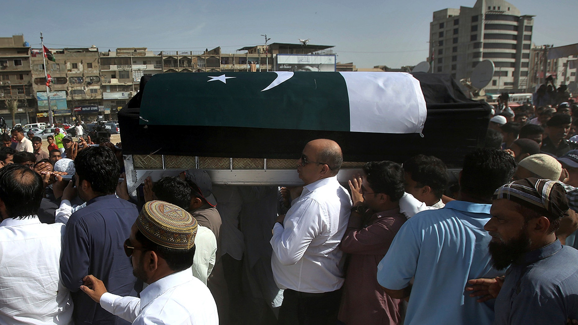 People carry the coffin of Sabika Sheikh, the Pakistani exchange student killed in a mass shooting at a high school in Texas, after offering funeral prayers in Karachi, Pakistan, Wednesday, May 23, 2018. Her body has arrived in the port city of Karachi, where her family lived and where she isbeing buried. (AP Photo/Fareed Khan)