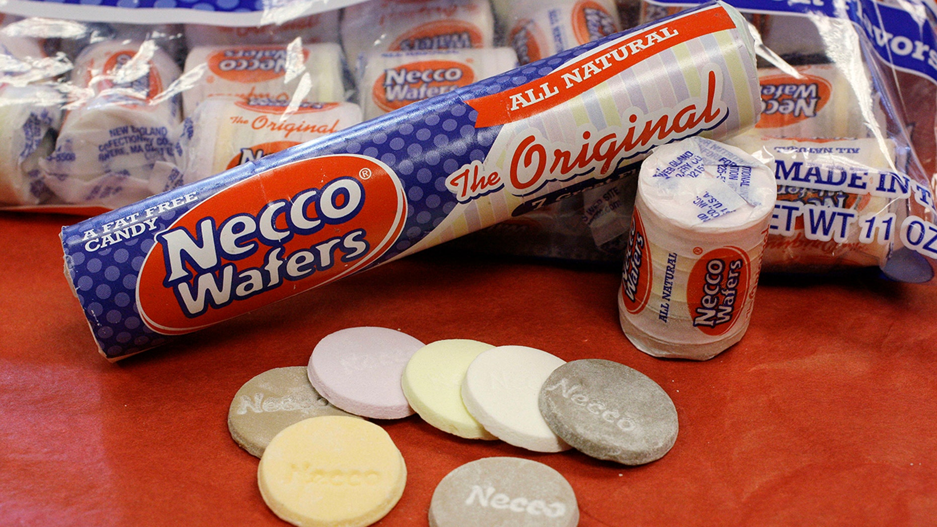 Four bidders were vying to buy New England Confectionery Company, of Revere, Mass., the bankrupt manufacturer of Necco Wafers, Sweethearts and other iconic candies.