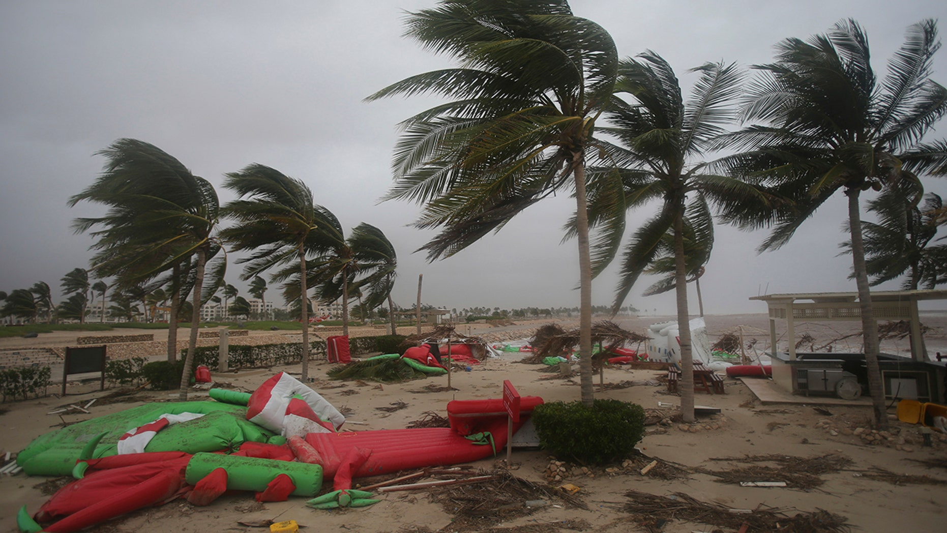 Debris litter a beach after Cyclone Mekunu in Salalah, Oman, Saturday, May 26, 2018. Cyclone Mekunu blew into the Arabian Peninsula early Saturday, drenching arid Oman and Yemen with rain, cutting off power lines, officials said. (AP Photo/Kamran Jebreili)