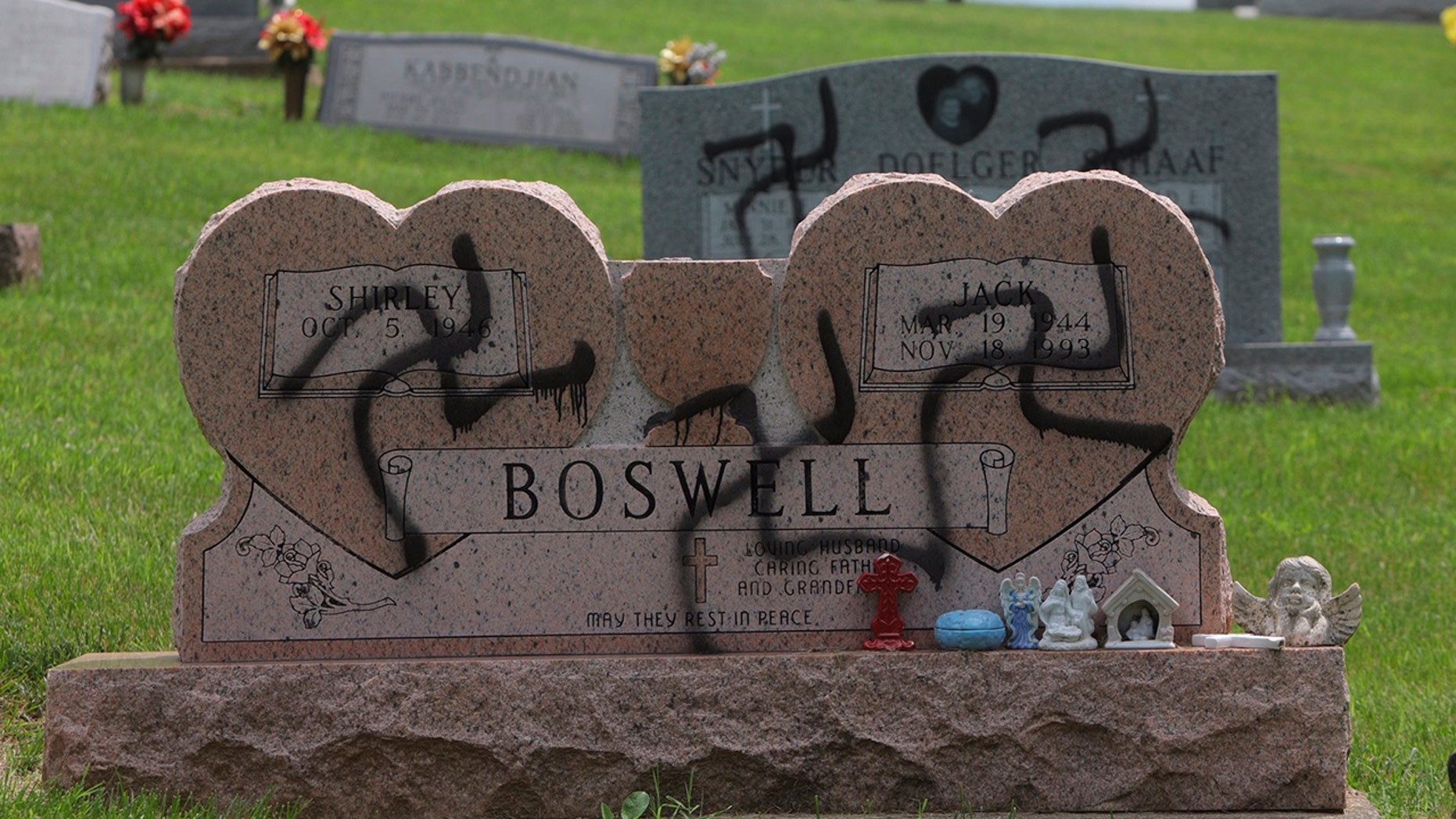 May 26, 2018: Grave markers with swastikas spray-painted on them stand in the Sunset Hill Cemetery in in Glen Carbon, Ill.