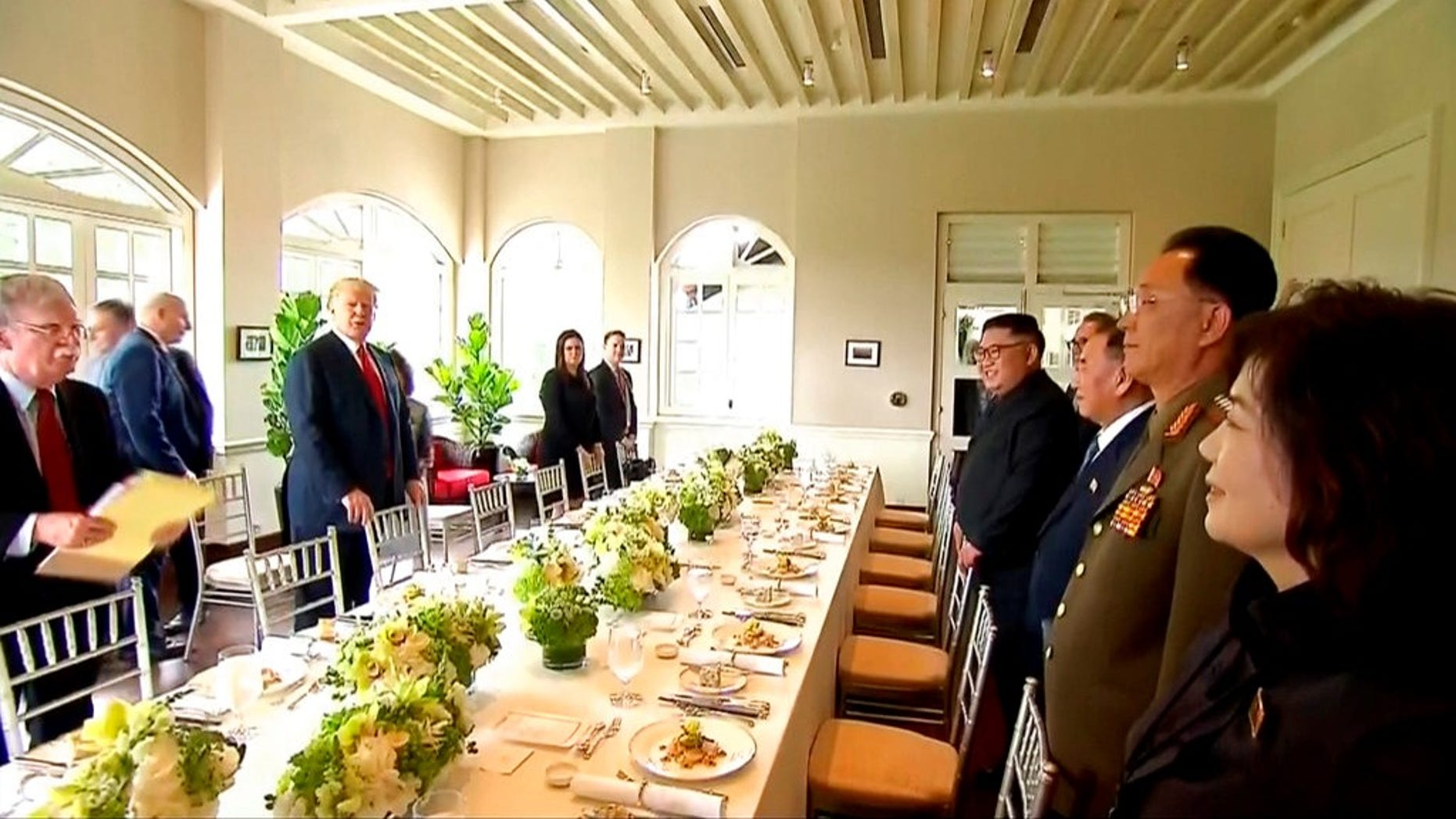 President Trump, Kim Jong Un and their aides arrive for a working lunch at Capella Hotel in Singapore.