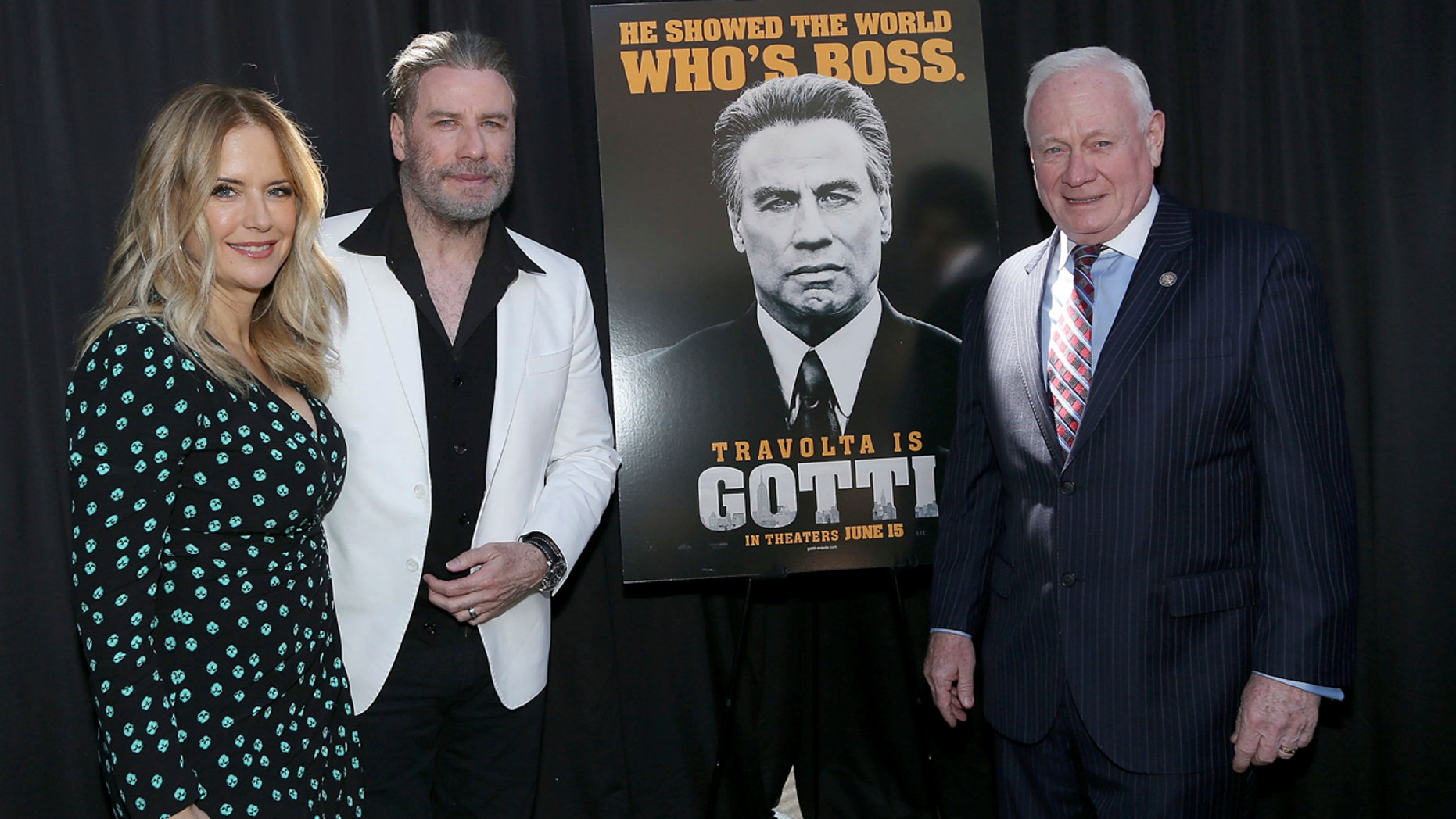 "Actors Kelly Preston, left, and John Travolta, stars of the upcoming film, ""Gotti,"" pose with New York state Sen. Marty Golden in Brooklyn, N.Y., June 12, 2018."