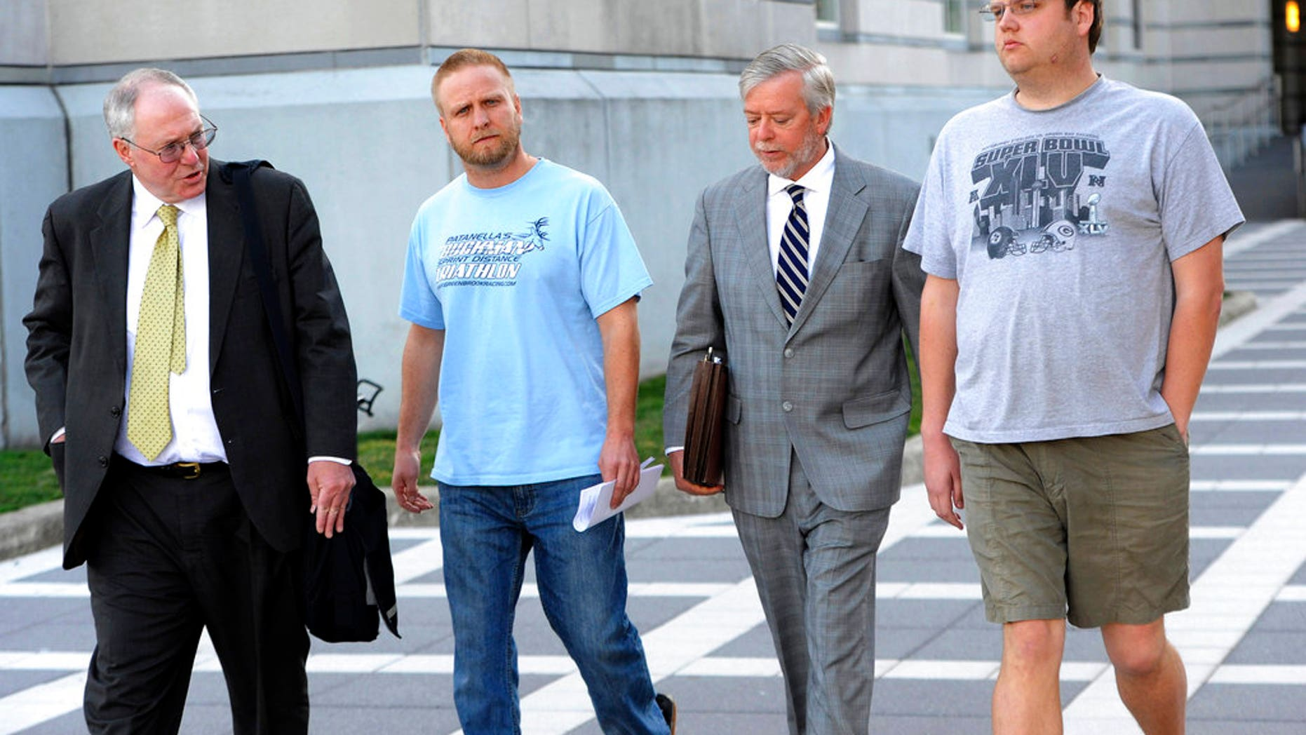 David Nicoll, second from left, and brother Scott Nicoll, right, leave a Newark, N.J., courthouse, accompanied by their representatives, in 2013.