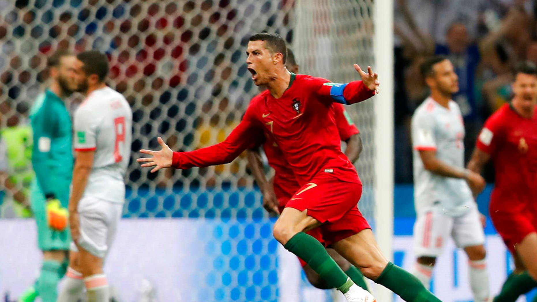 Cristiano Ronaldo celebrates after scoring his third goal with a free kick in Portugal's opening World Cup match against Spain at Fisht Stadium in Sochi, Russia, on Friday.