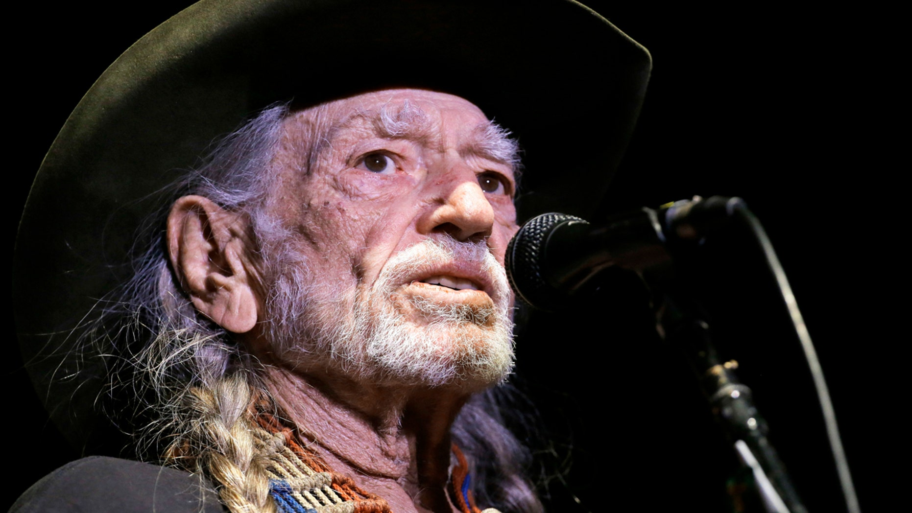 """Willie Nelson performs in Nashville, Tenn., Jan. 7, 2017. Nelson has called out current immigration policies as """"outrageous"""" and extended an offer to meet President Donald Trump at one of the detention centers at the U.S.-Mexico border."""