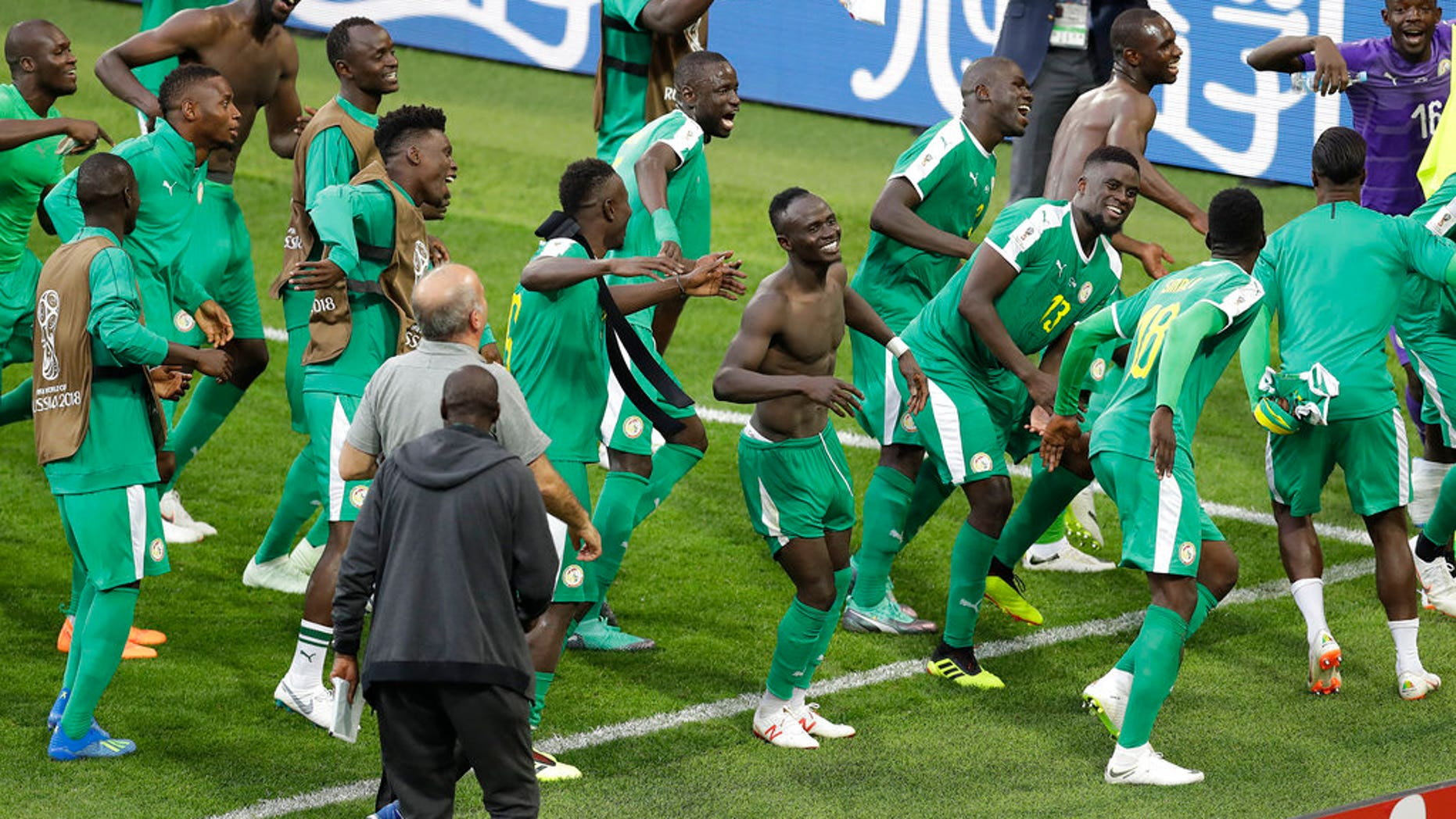 Senegal players celebrate after winning over Poland at the 2018 soccer World Cup in Moscow, Russia, Tuesday, June 19, 2018.