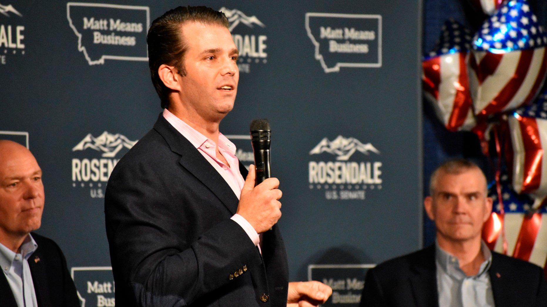 Donald Trump Jr., center, speaks to Montana Republicans at the state party's annual convention as U.S Rep. Greg Gianforte, left, and U.S. Senate candidate Matt Rosendale, right, look on, in Billings, June 22, 2018.