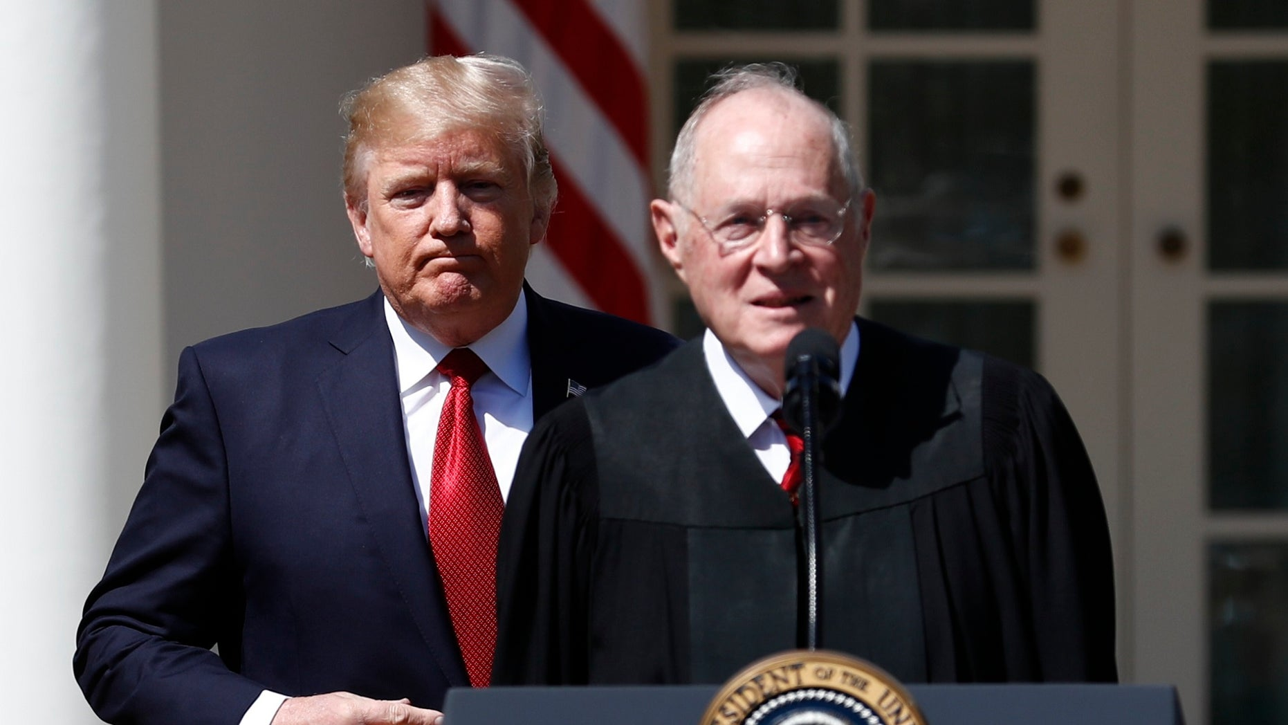 FILE - In this April 10, 2017 photo, President Donald Trump, left, and Supreme Court Justice Anthony Kennedy participate in a public swearing-in ceremony for Justice Neil Gorsuch in the Rose Garden of the White House White House in Washington. The 81-year-old Kennedy said Tuesday, June 27, 2018, that he is retiring after more than 30 years on the court.