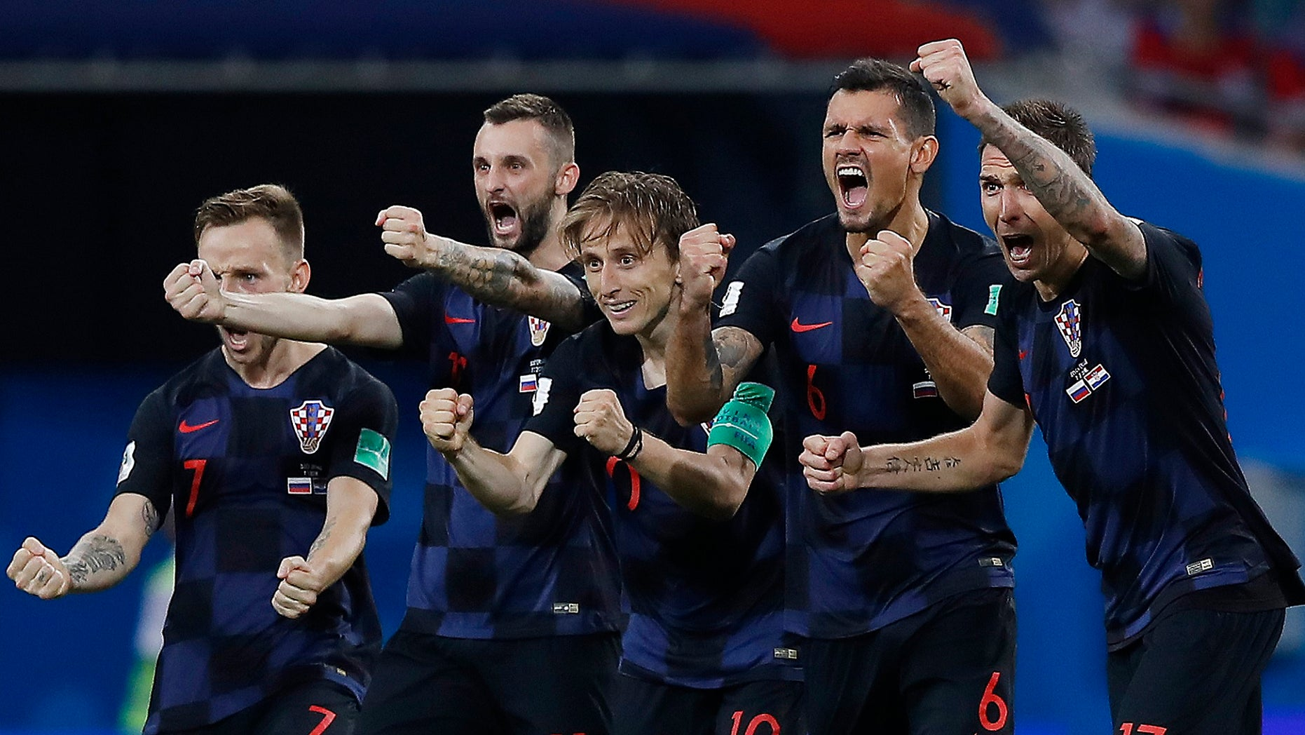 Croatia national soccer team players celebrate after a penalty is saved in a shootout during the quarterfinal match of this year's World Cup tourney. Croatia won the match 4-3.