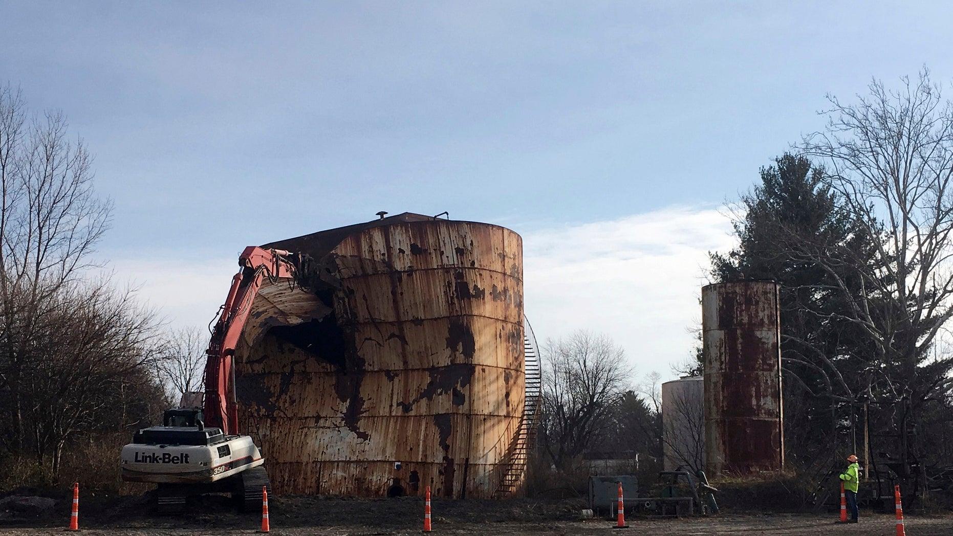 A tank at a Kiel Bros. property is torn down in Indianapolis, Dec. 11, 2017.