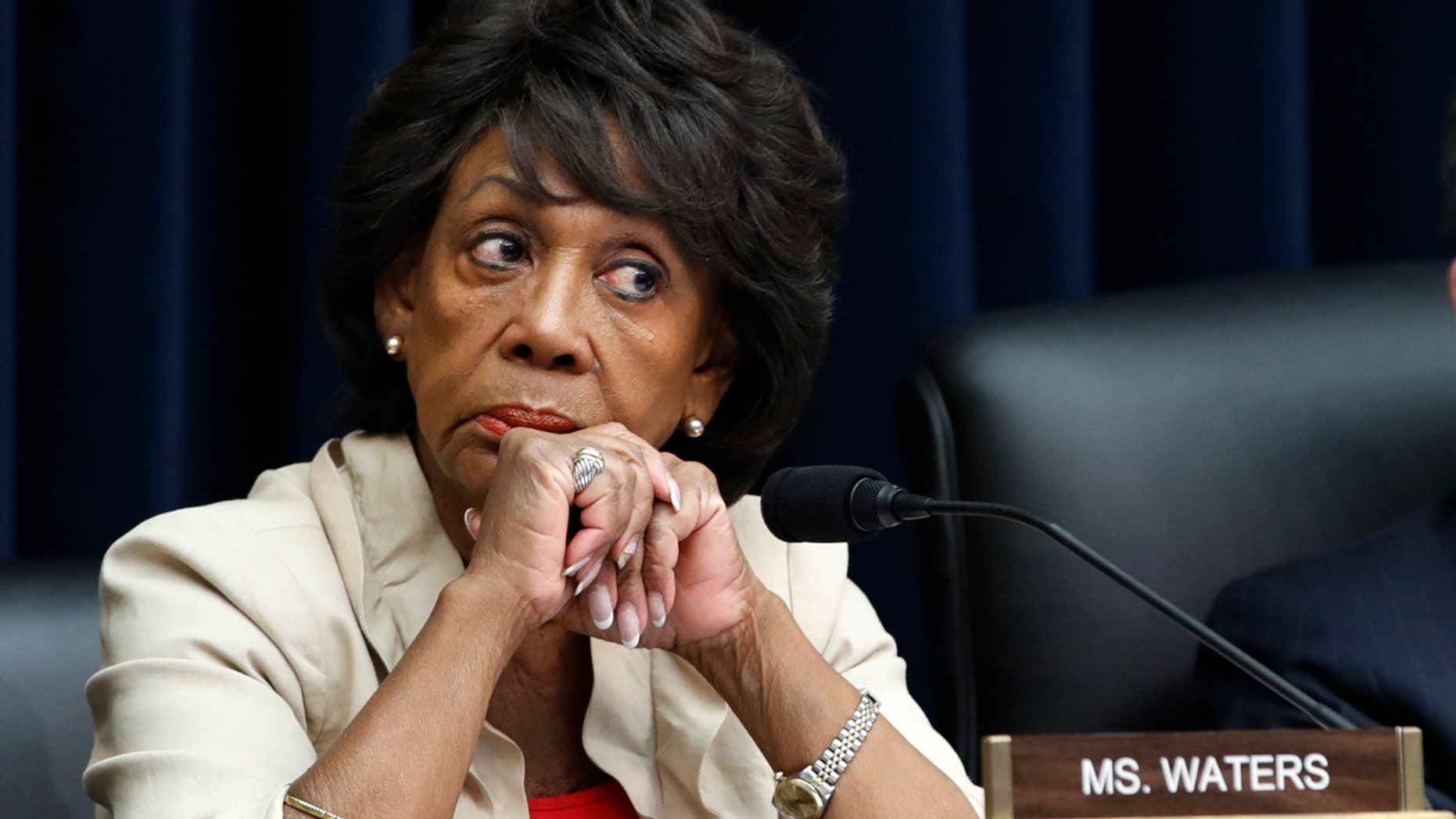 House Committee on Financial Services Ranking Member Rep. Maxine Waters, D-Calif., left, listens during a hearing, Wednesday, July 18, 2018, on Capitol Hill in Washington.