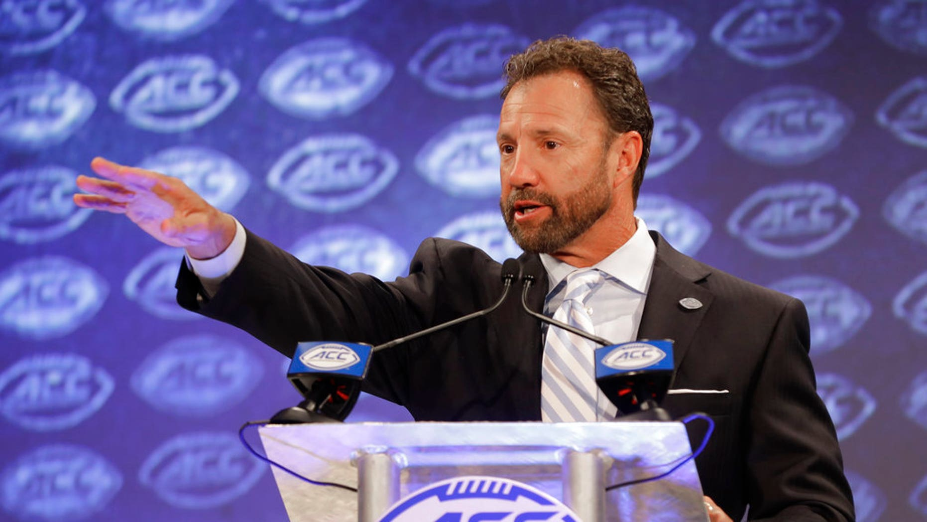 North Carolina head coach Larry Fedora answers a question during a news conference at the NCAA Atlantic Coast Conference college football media day in Charlotte, N.C., Wednesday, July 18, 2018.