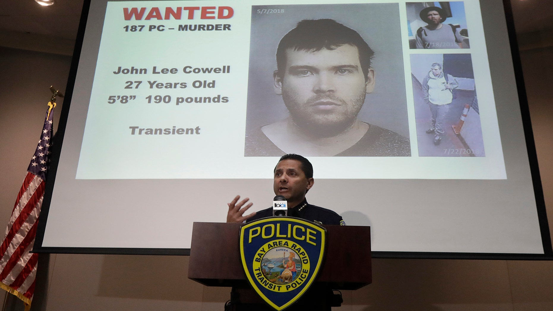 Bay Area Rapid Transit Police Chief Carlos Rojas speaks at a news conference in front of images of John Lee Cowell, a suspect wanted in the stabbings of two women at a BART station, in Oakland, Calif., Monday, July 23, 2018.