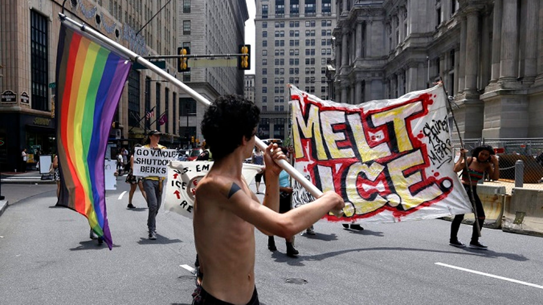 Protesters camped outside City Hall march in the street after a decision about ICE was made, Friday July 27, 2018, in Philadelphia. Mayor Jim Kenney announced Friday that Philadelphia will stop giving U.S. Immigration and Customs Enforcement (ICE) access to a real-time arrest database.