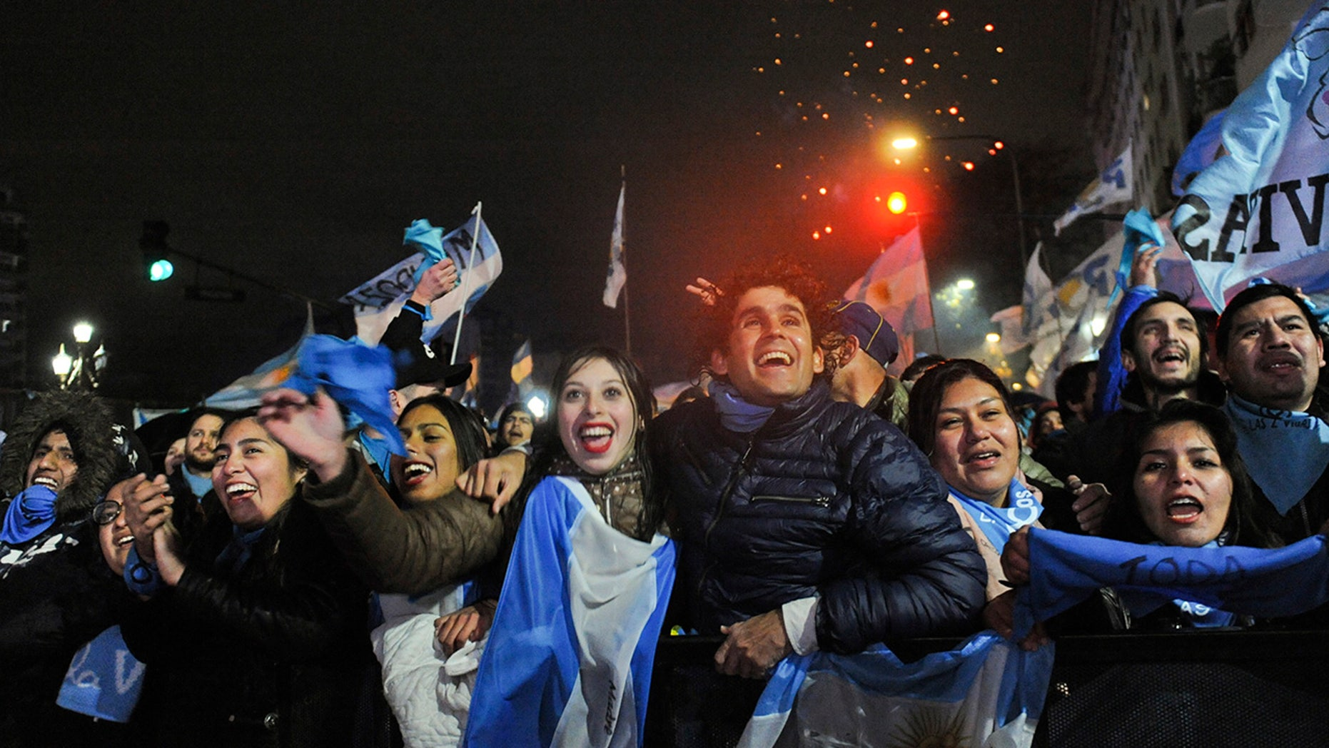 Demonstrators against decriminalizing abortion celebrate outside Congress after the Argentine Senate rejected a bill to legalize elective abortion for pregnancies up to 14 weeks