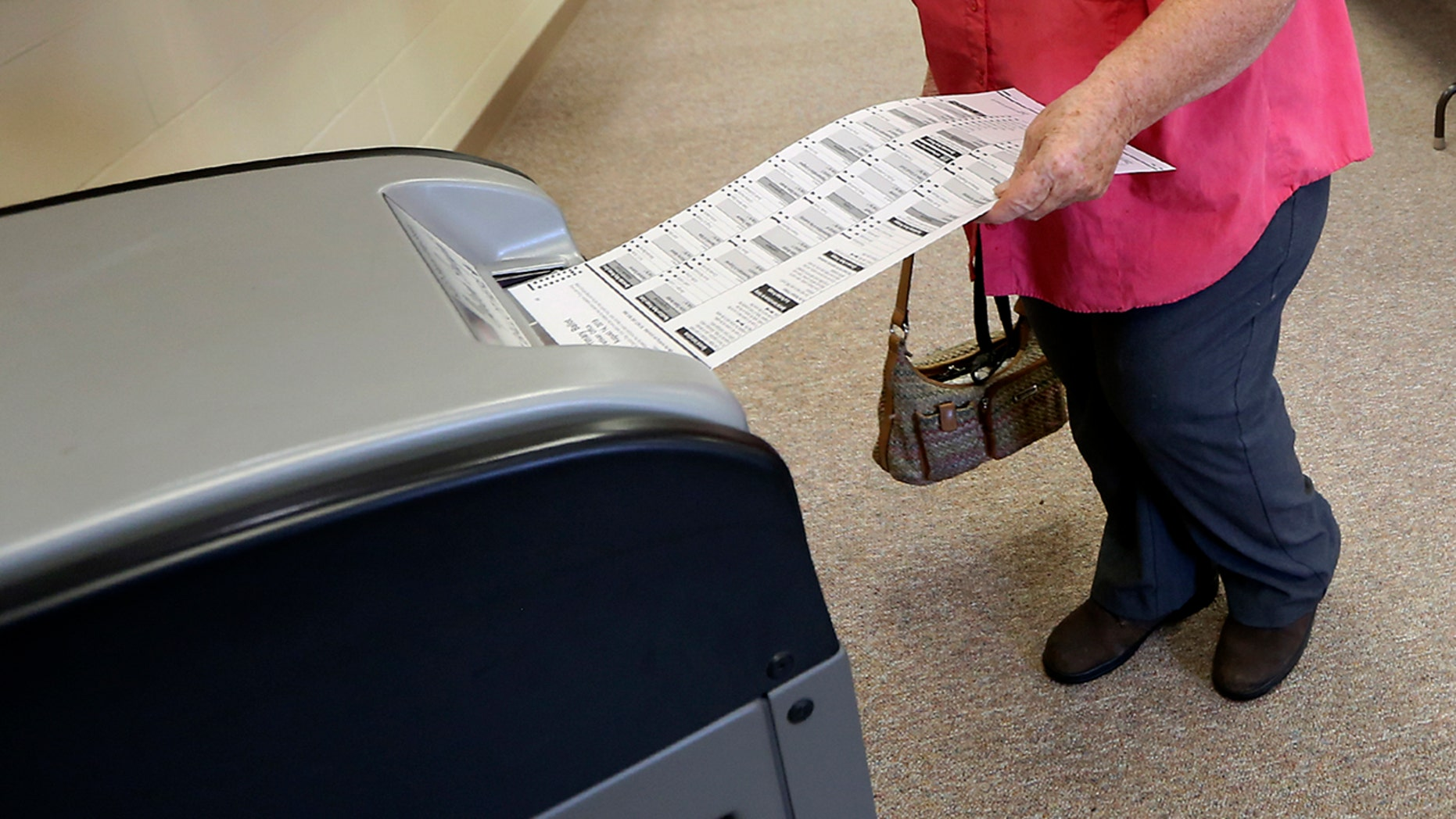 A voter casts her ballot in Wisconsin's primary election, Tuesday, Aug. 14, 2018.