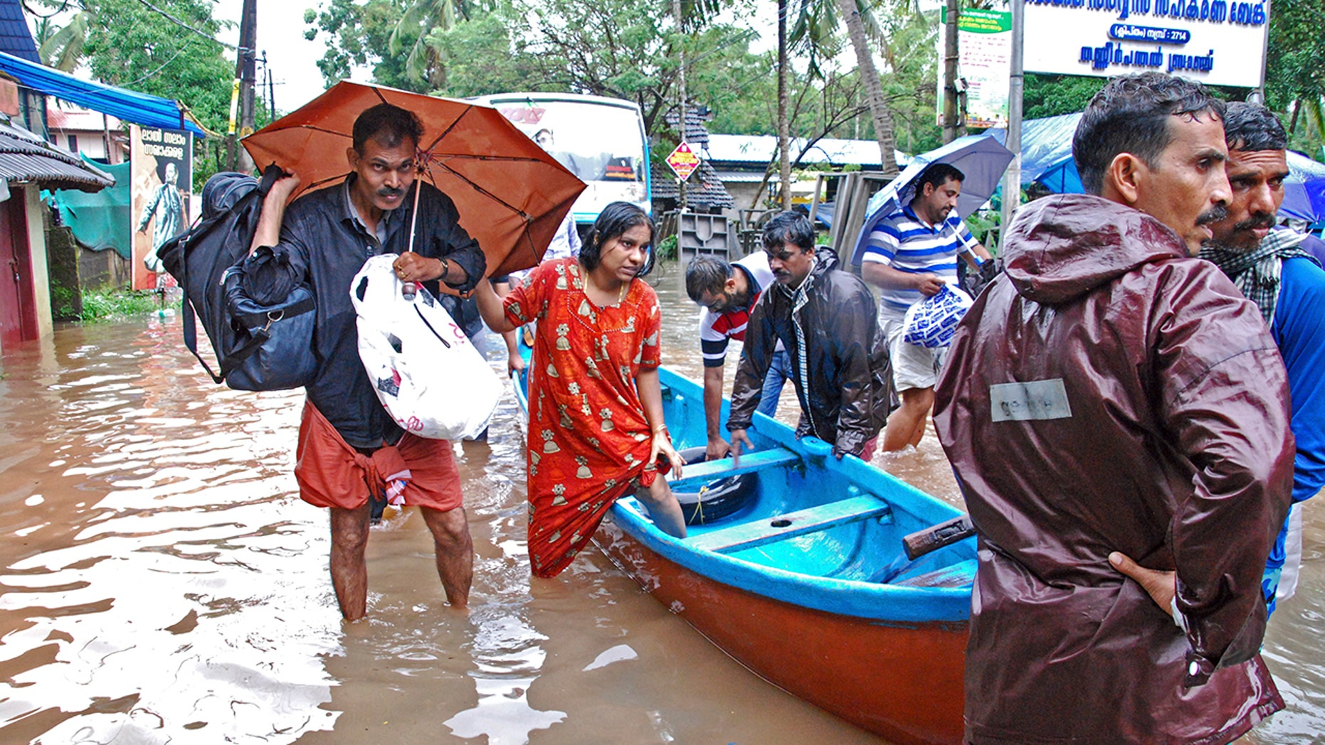 Flood victims are evacuated to safer areas in Kozhikode, in the southern Indian state of Kerala, Thursday, Aug. 16, 2018. Torrential monsoon rains have disrupted air and train services in the southern Indian state of Kerala, where flooding, landslides and bridge collapses have killed dozens of people in the past week, officials said. (AP Photo/K. Shijith)