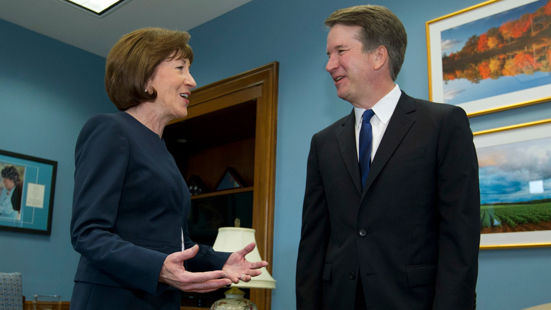 Sen. Susan Collins, R-Maine, speaks with Supreme Court nominee Judge Brett Kavanaugh at her office, before a private meeting on Capitol Hill in Washington on Tuesday, Aug. 21, 2018.