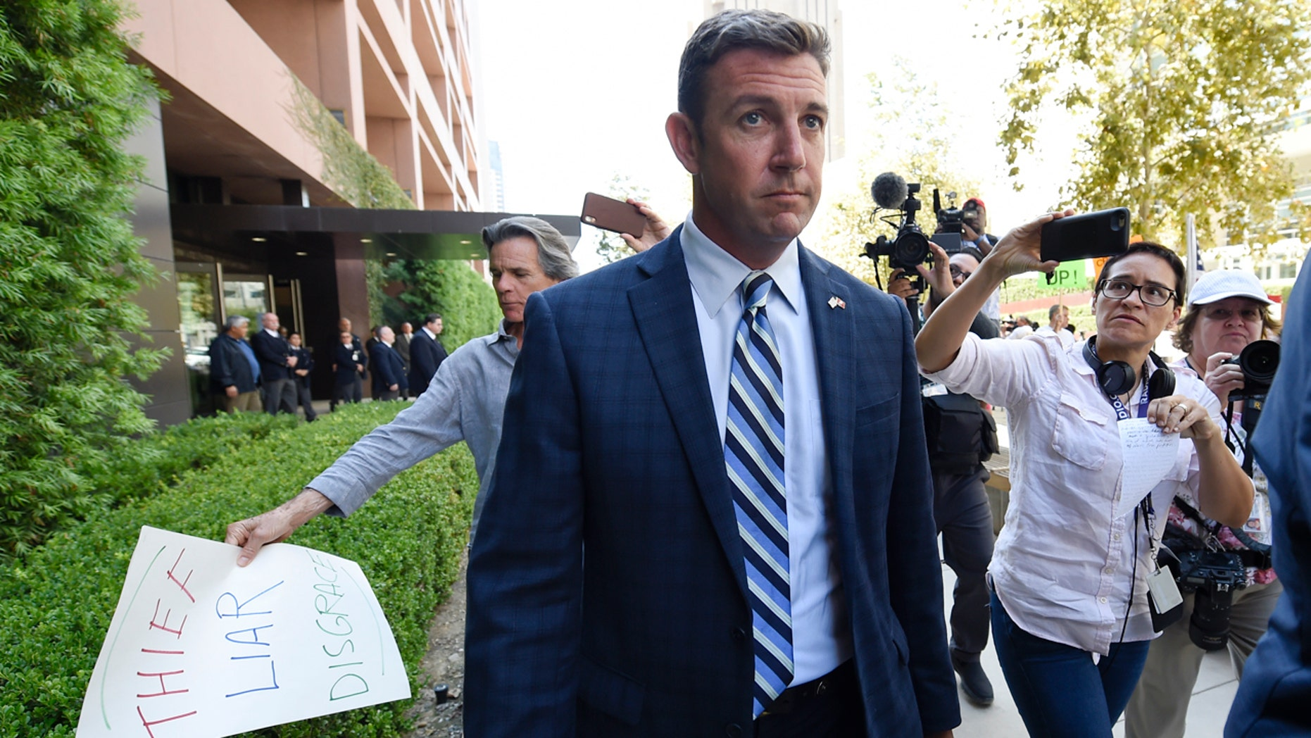 U.S. Rep. Duncan Hunter leaves an arraignment hearing in San Diego, Aug. 23, 2018.